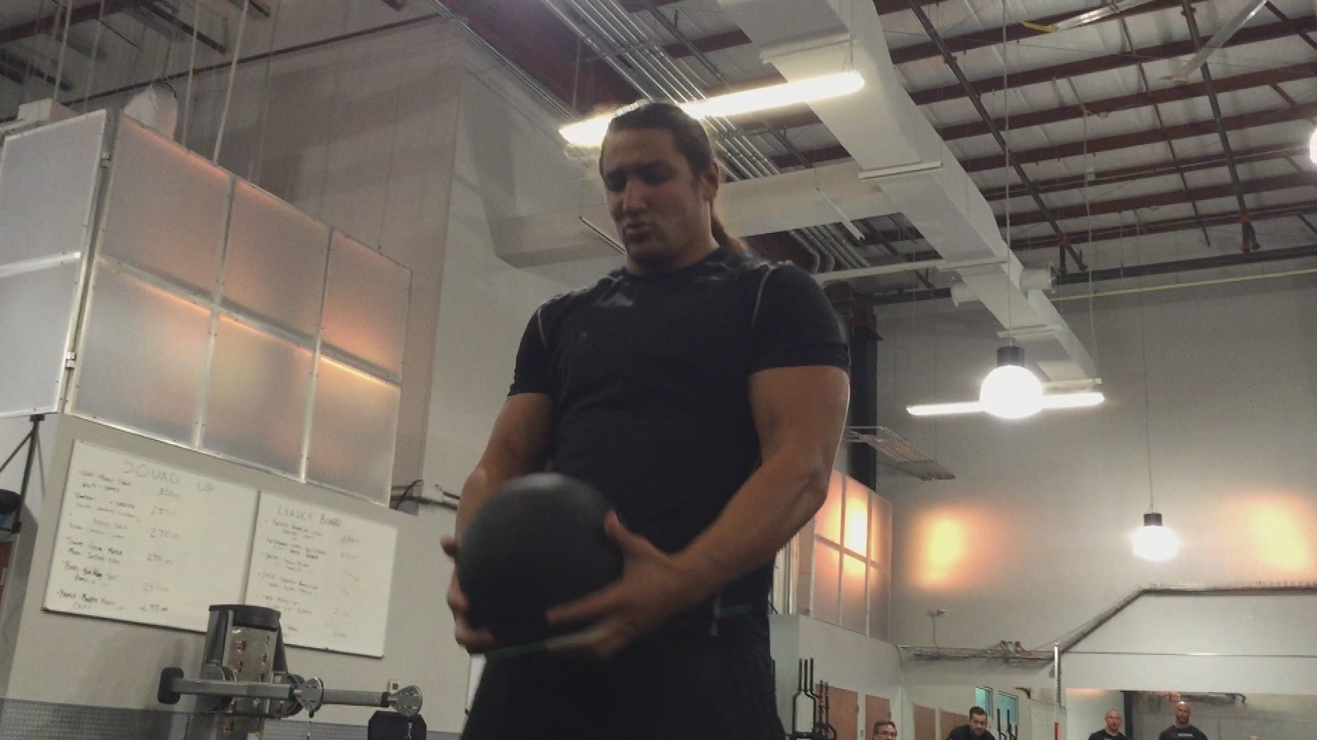 Tino Sabbatelli and Riddick Moss try to outdo each other in the medicine ball throw