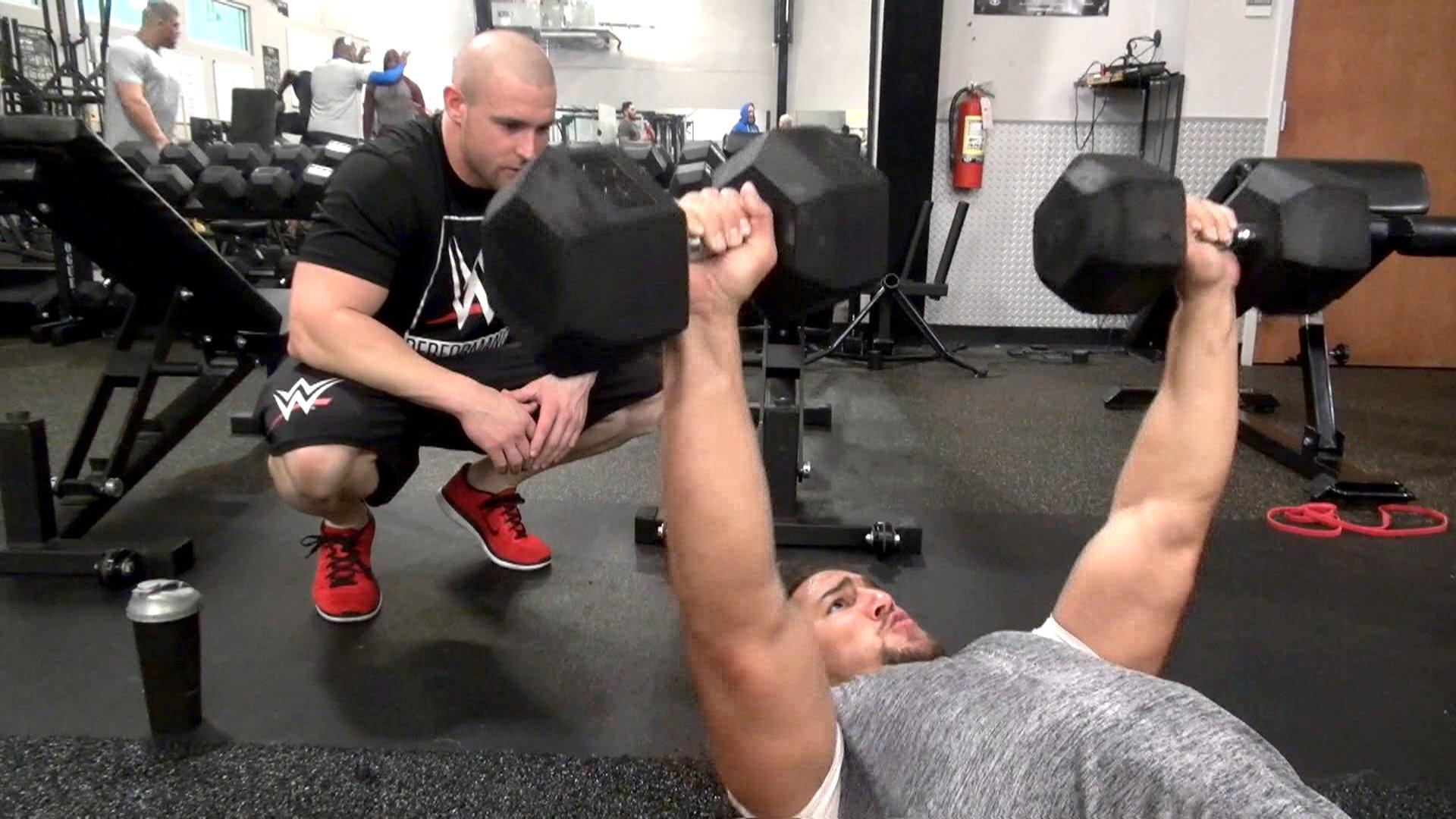 Riddick Moss and Elias Samson build body armor with floor bench presses