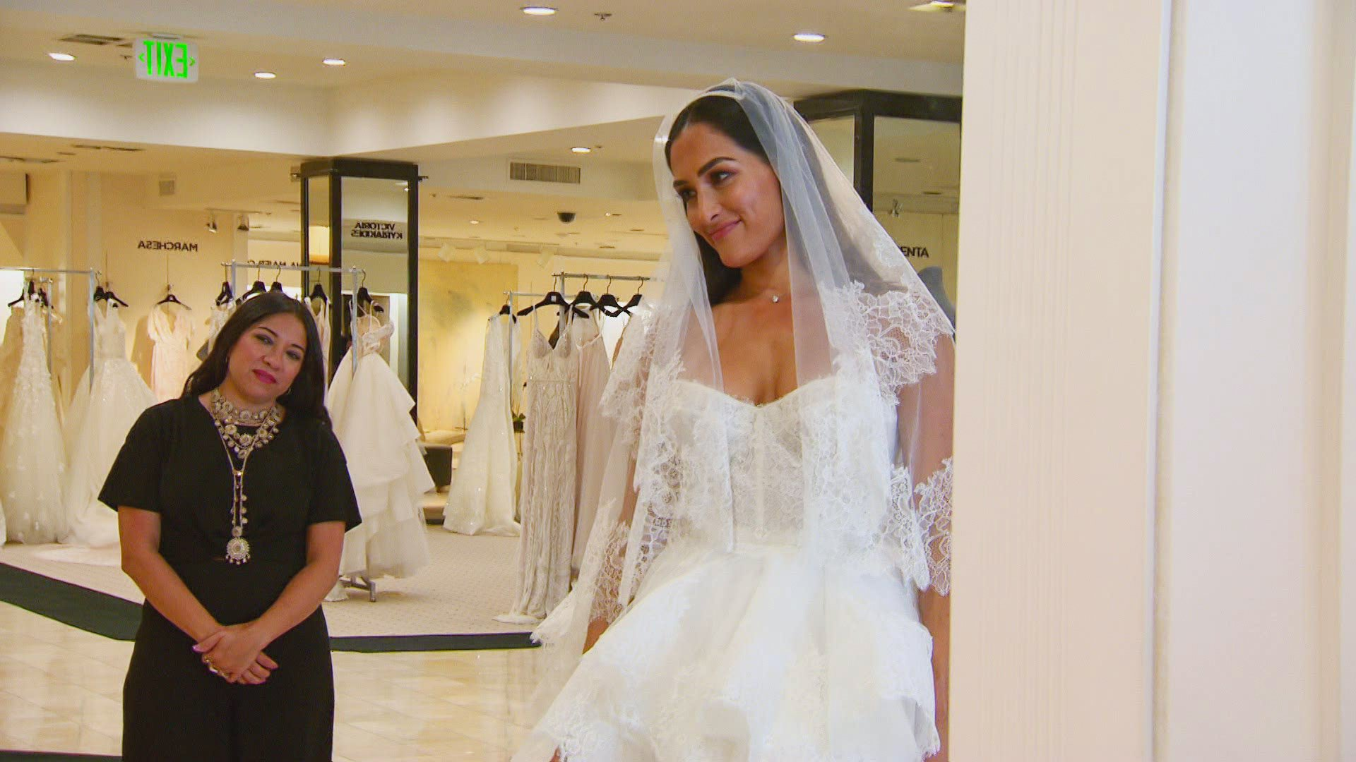 A Reluctant Nikki Bella Tries On Wedding Dresses In Front Of The