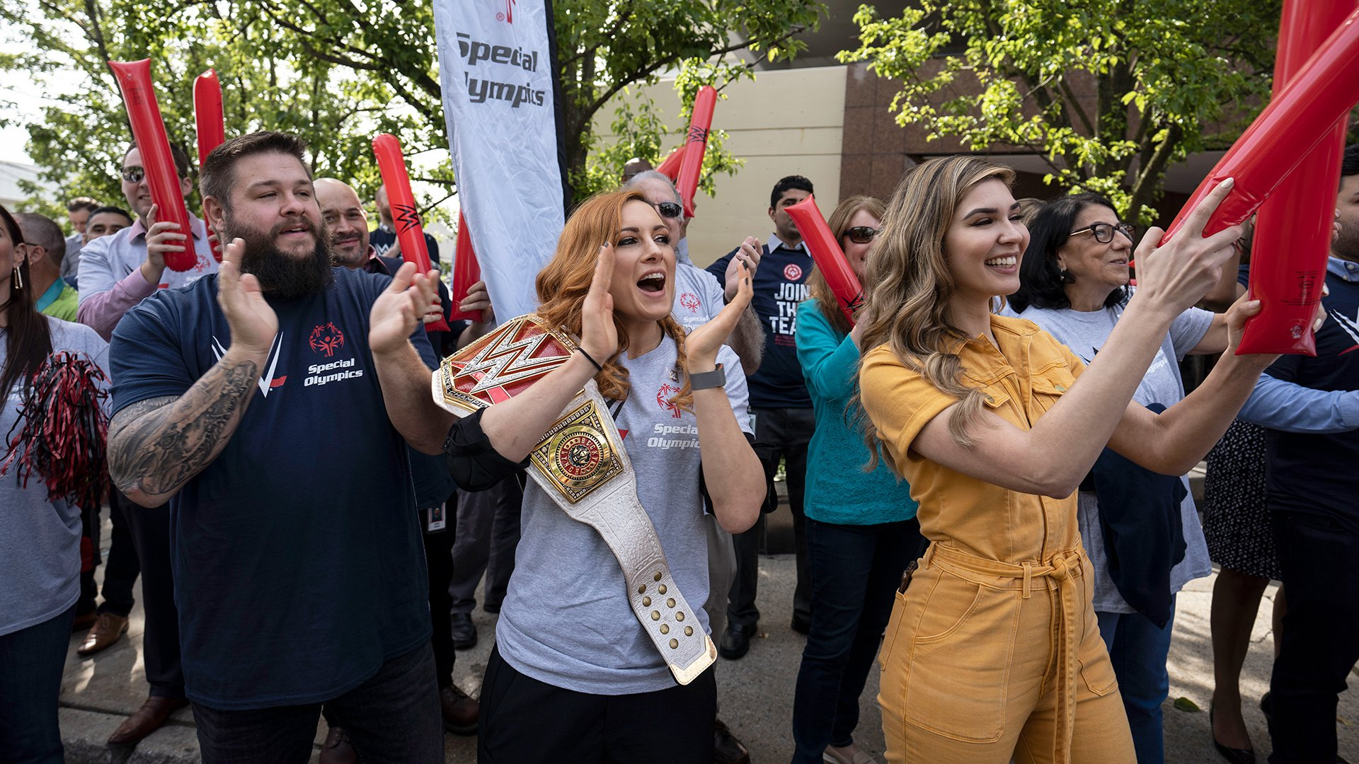 Becky Lynch leads a cheer for the Special Olympics Connecticut Law Enforcement Torch Run at WWE Headquarters