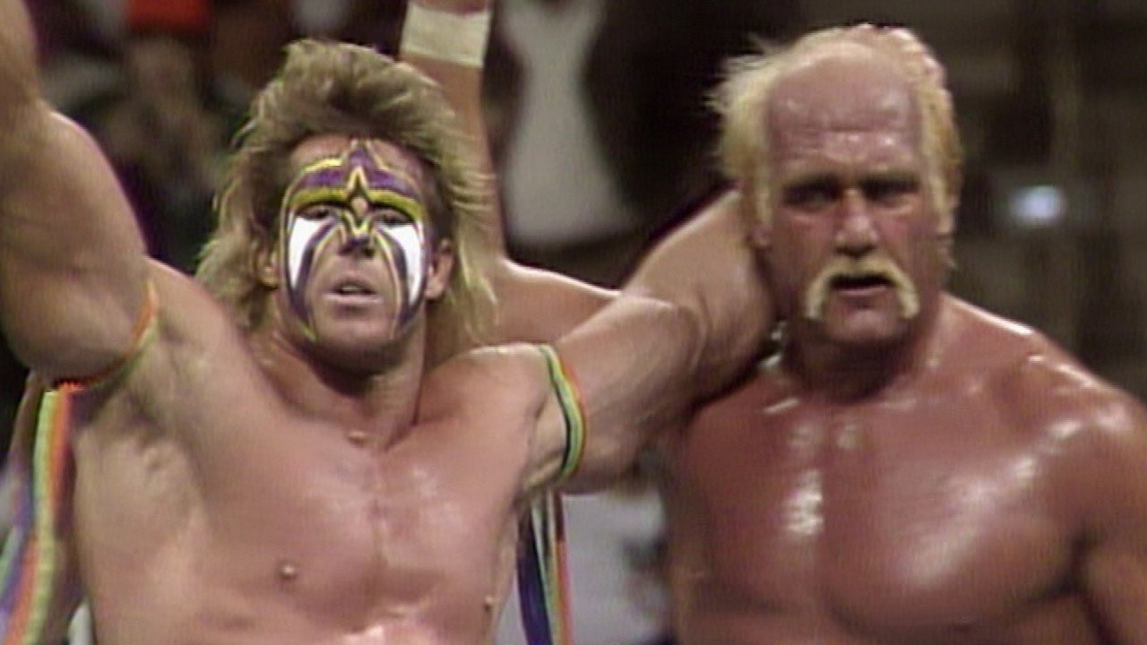 Hulk Hogan and Ultimate Warrior stand tall in 1990