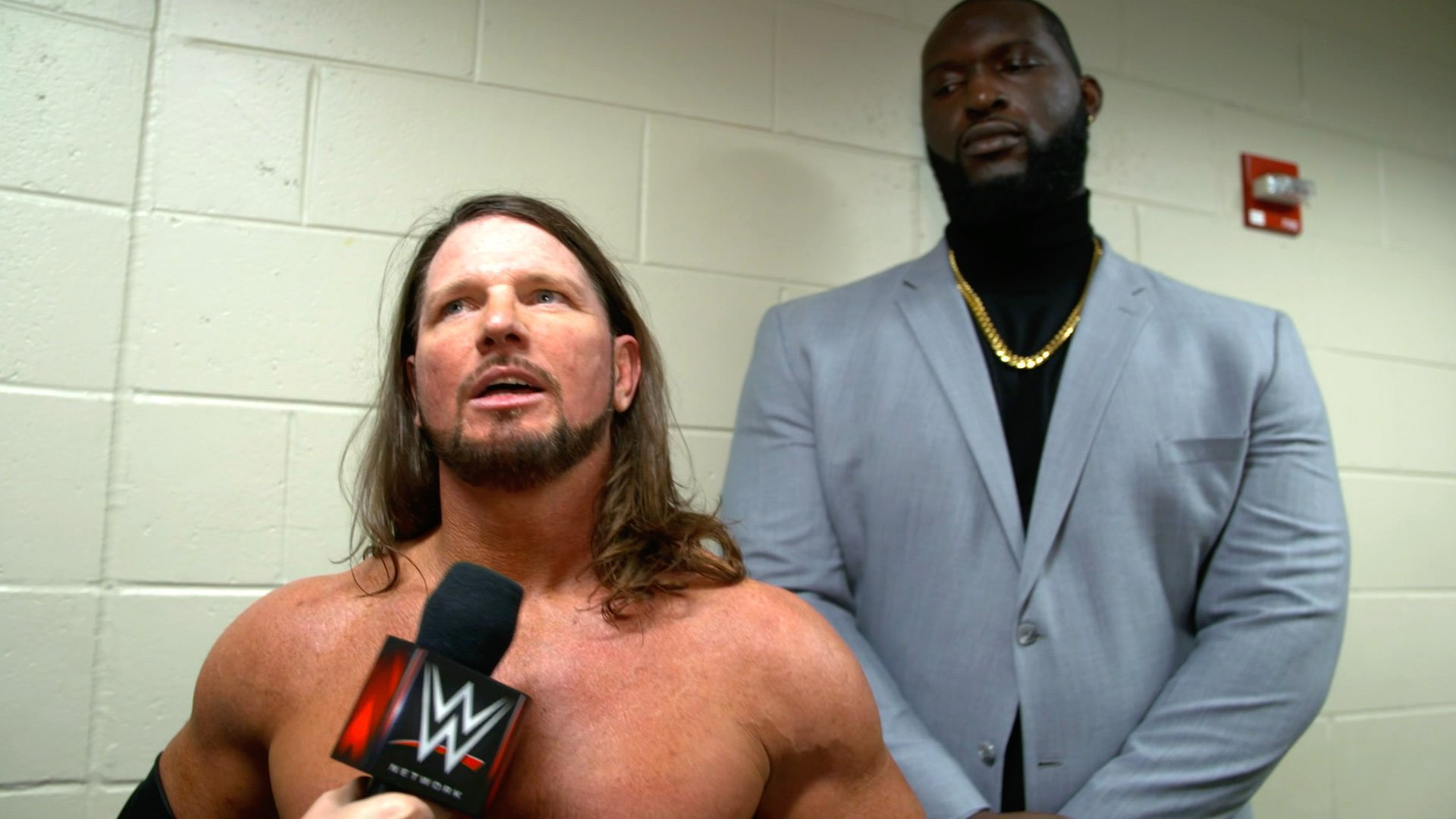 WWE Now Using Omos As Ring Name For AJ Styles' Bodyguard