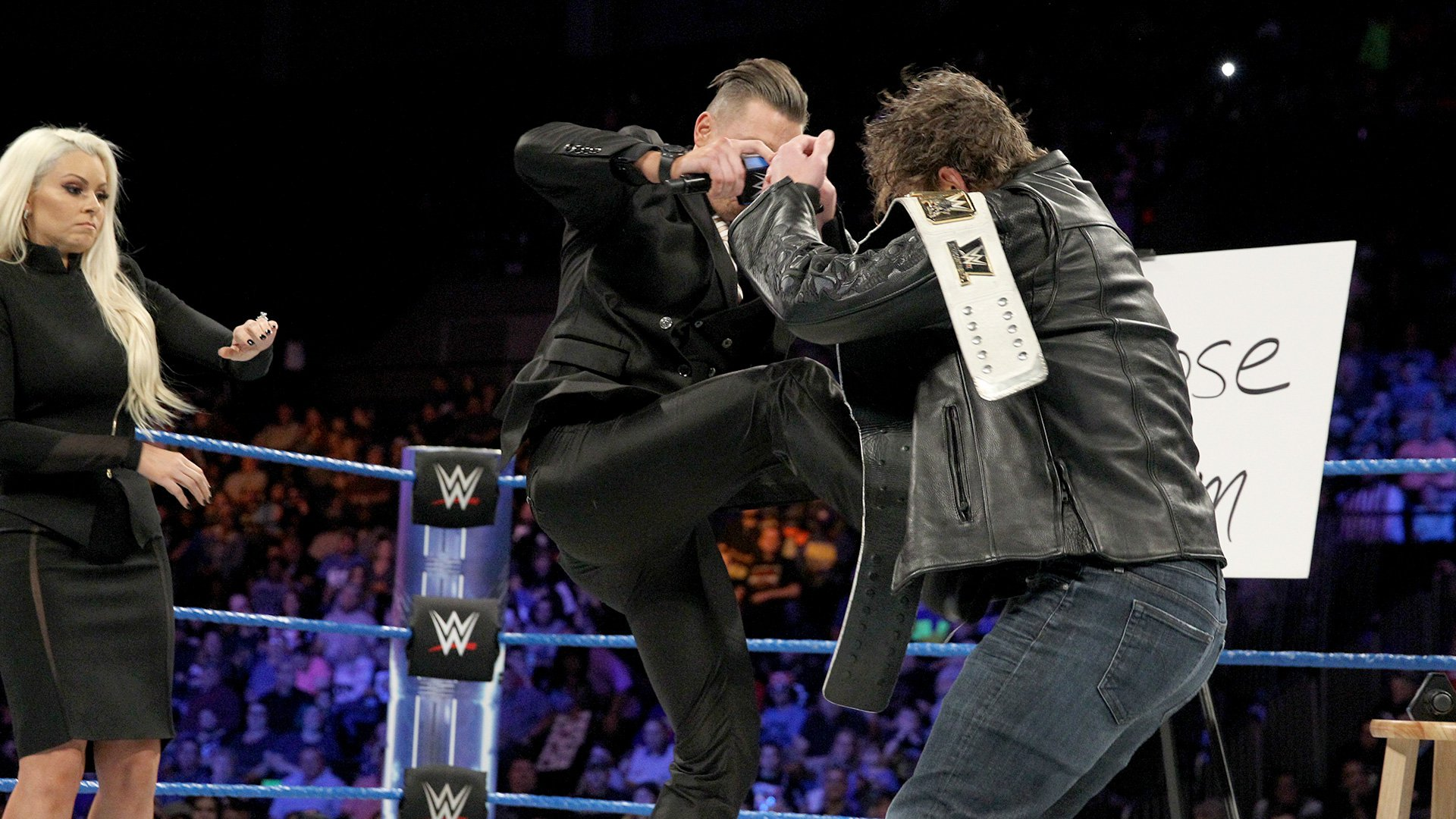 The Miz unleashes an attack on Ambrose.