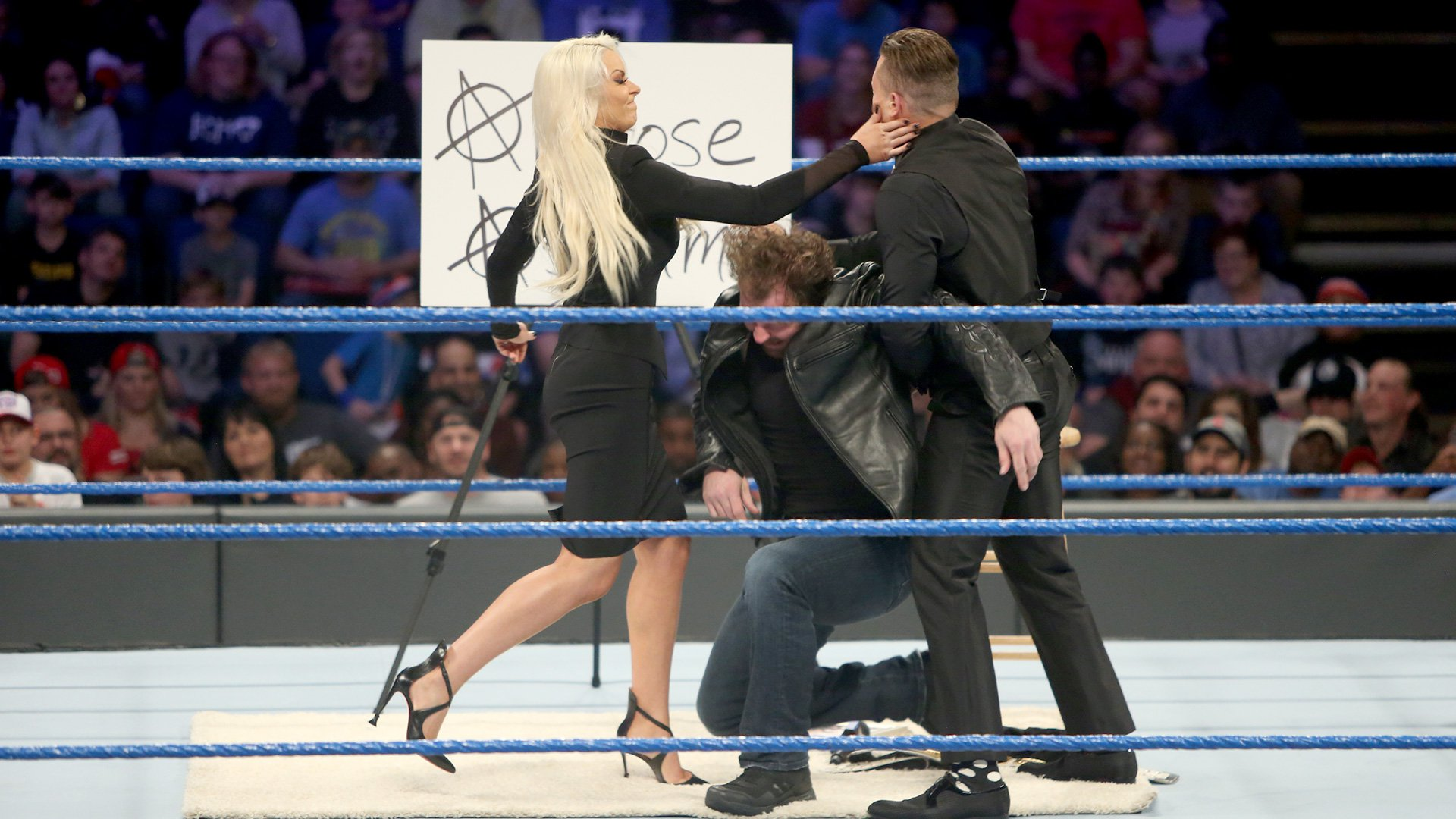 He holds up Ambrose for Maryse to hit him, but Ambrose ducks and Maryse accidentally slaps her husband!