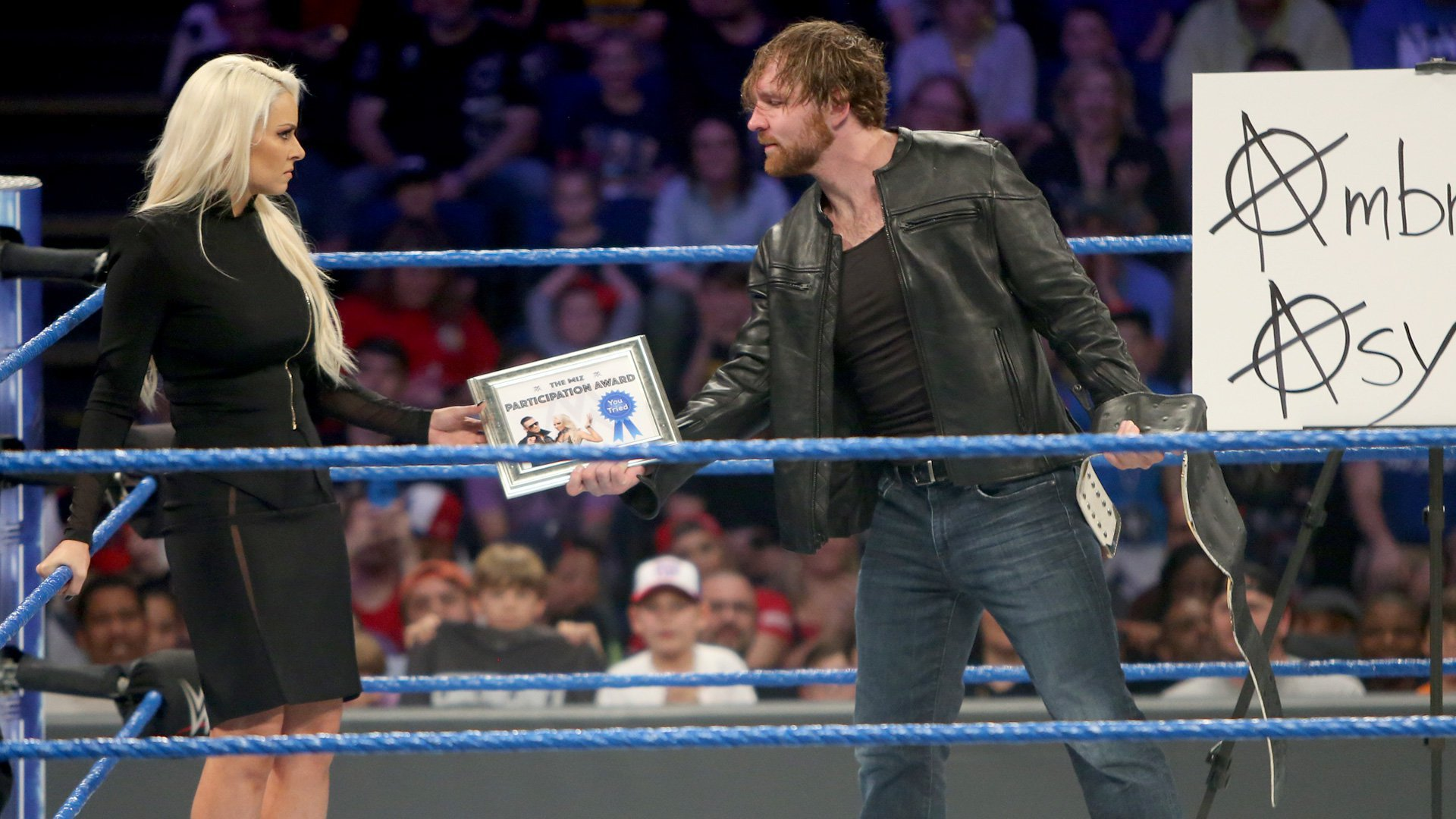 He then hands the award to Maryse.