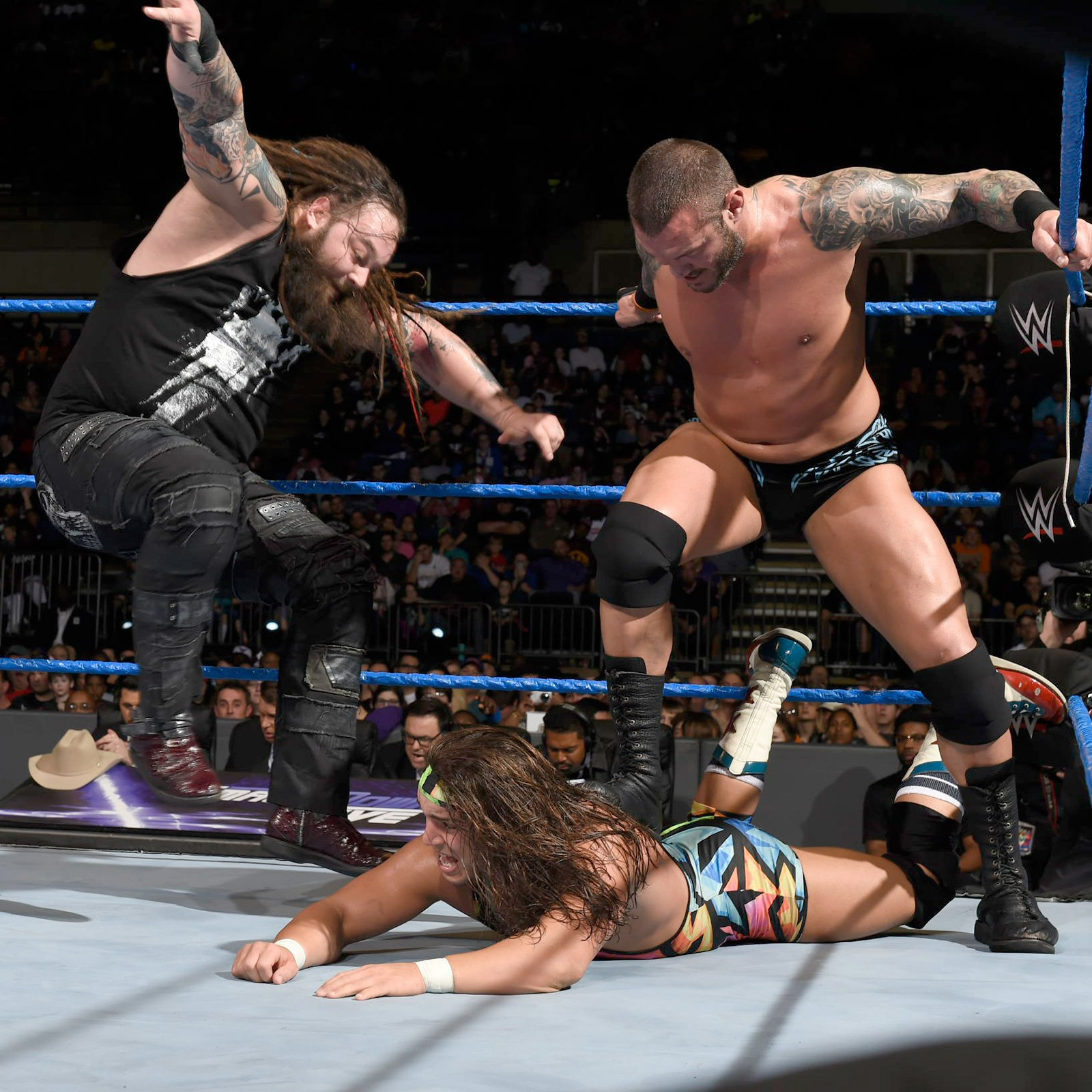 Wyatt and Randy Orton double team the former Olympian.