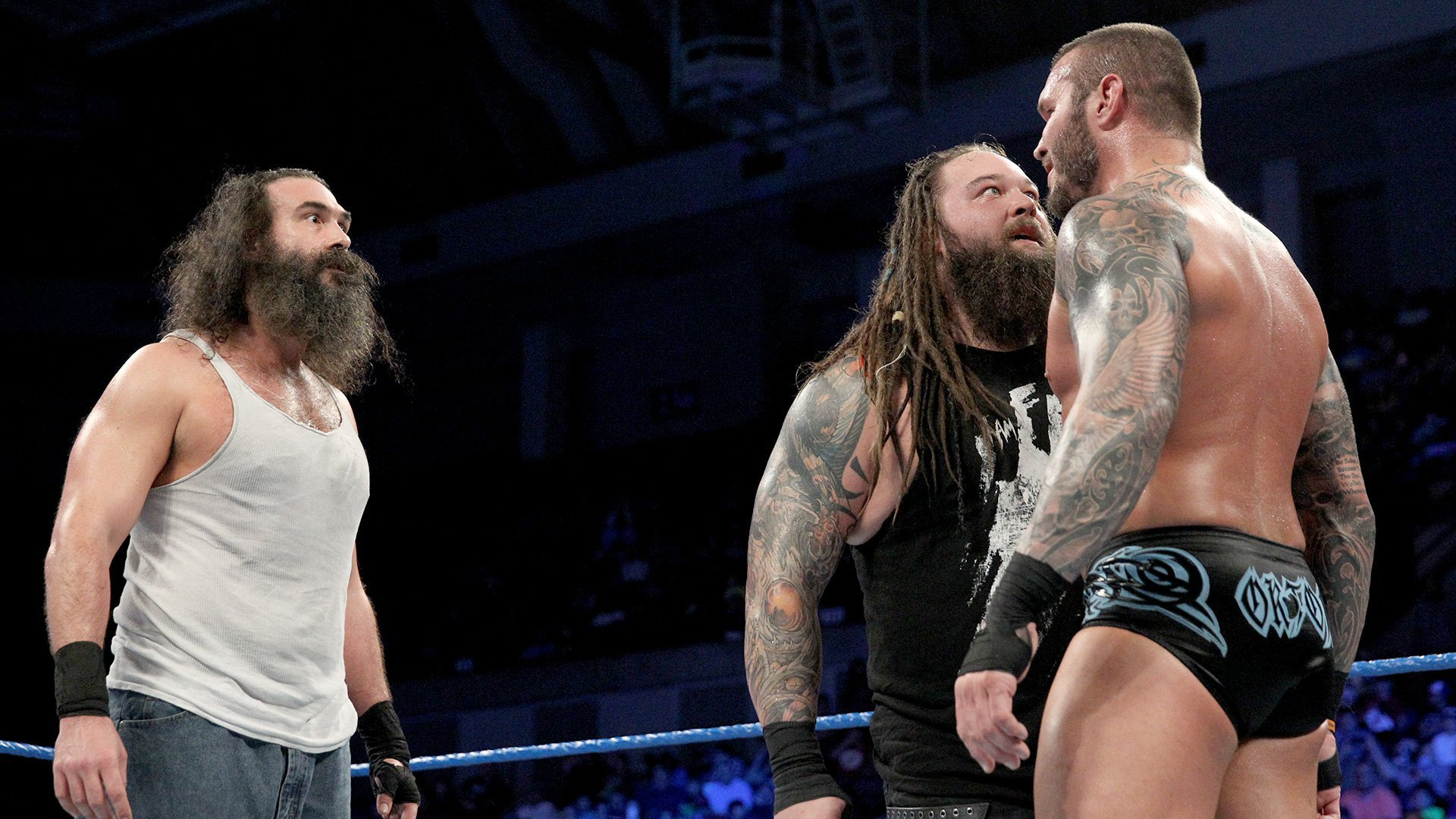 Bray rises and stares down both of his followers before promptly exiting.