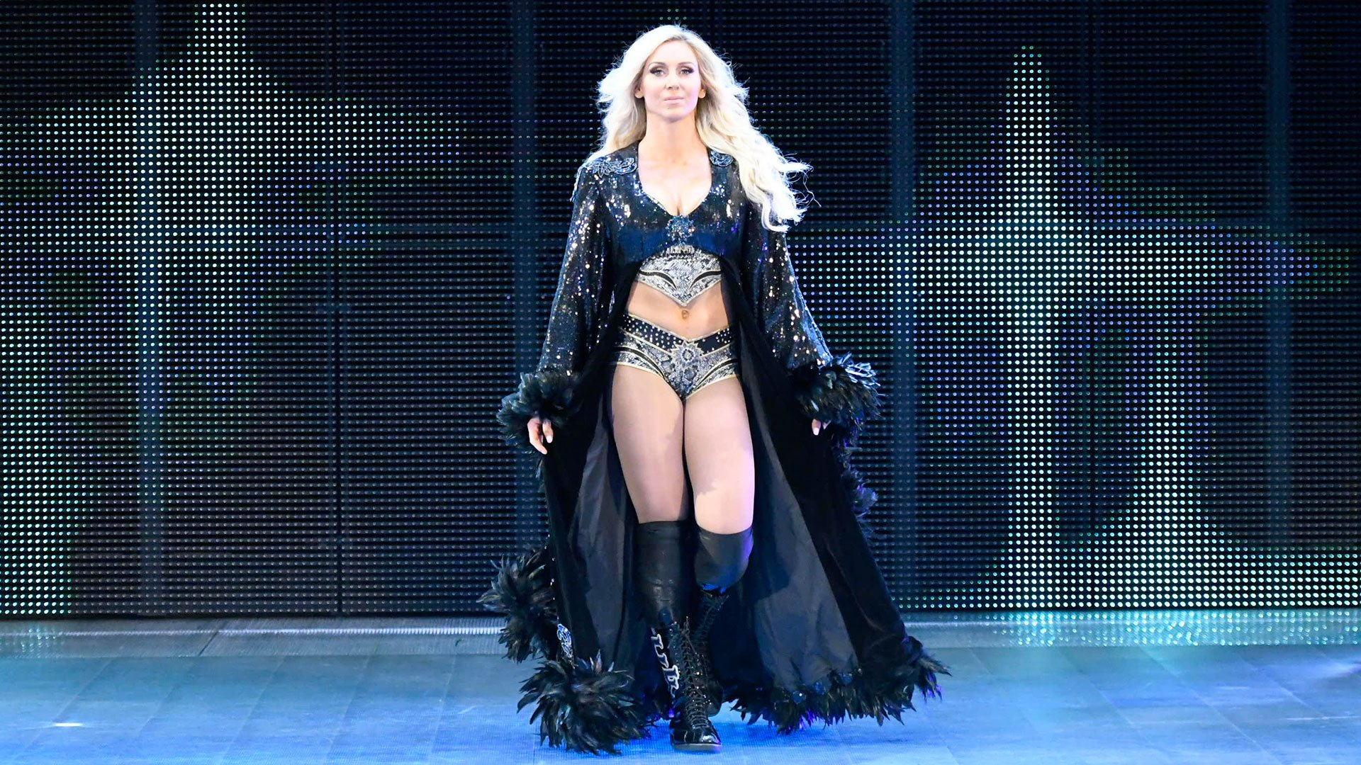 Charlotte hits the ring to kick off SmackDown LIVE.