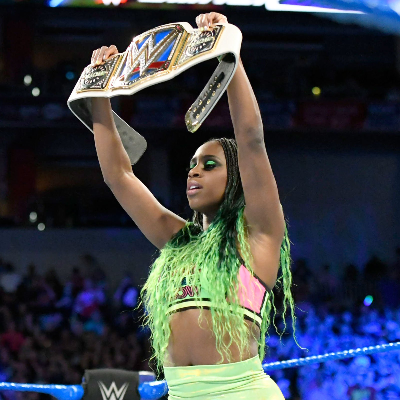 ... and Naomi stands tall with her SmackDown Women's Championship.