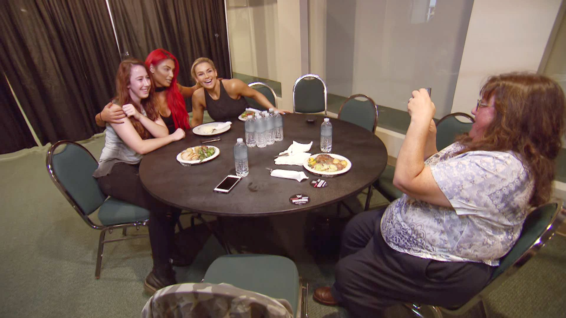 Eva and Natalya meet with a contest winner backstage.