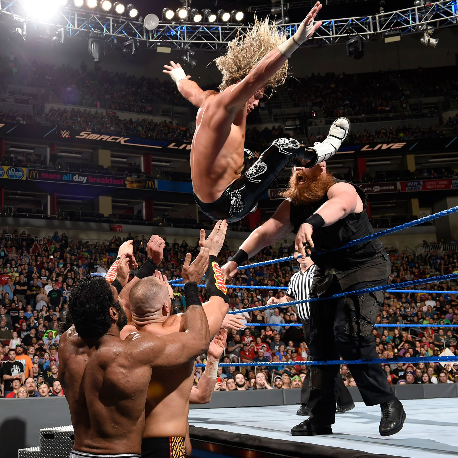 Rowan hurls Ziggler over the top rope.