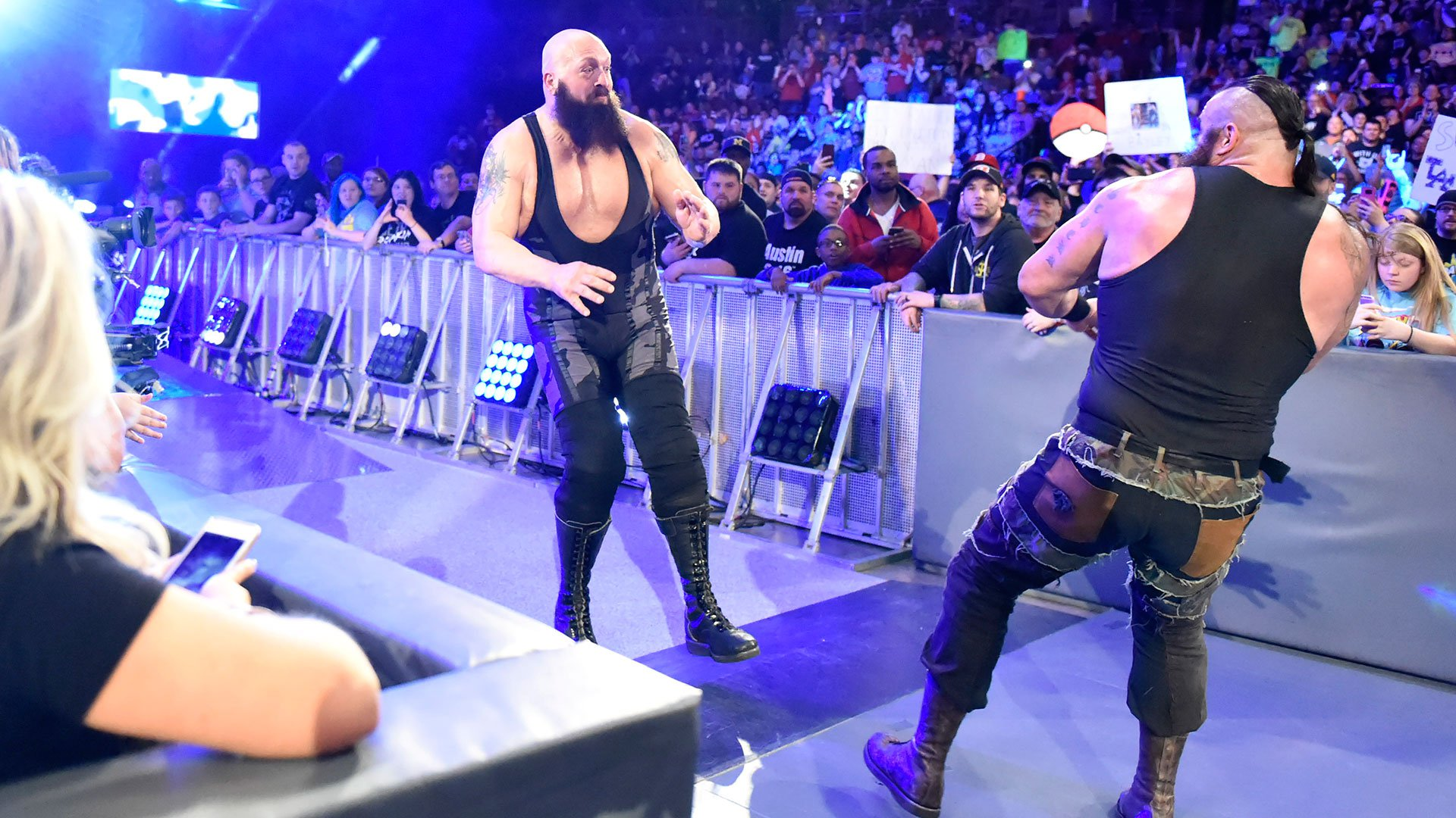 Strowman meets Big Show in the aisle and the fight is on.