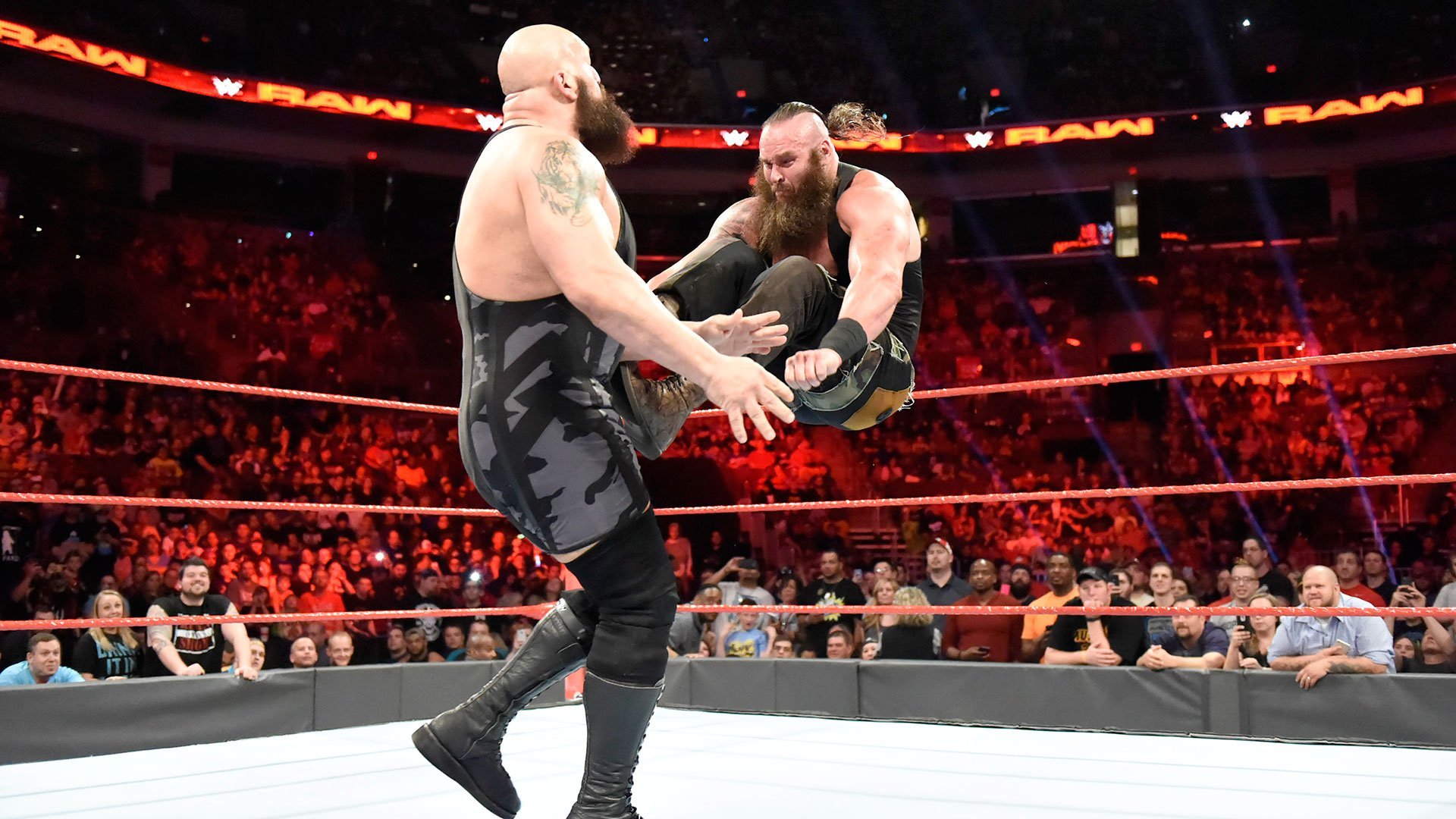 Strowman leaps to hit a dropkick.