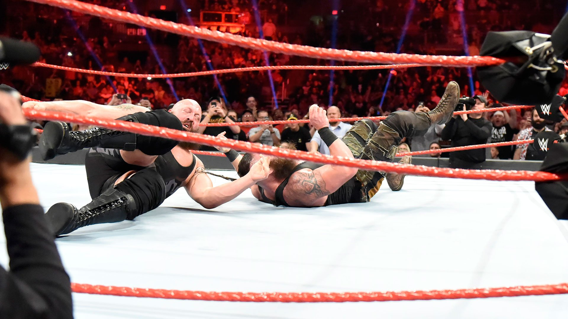 Strowman and Big Show hit the canvas with earth-shaking impact.