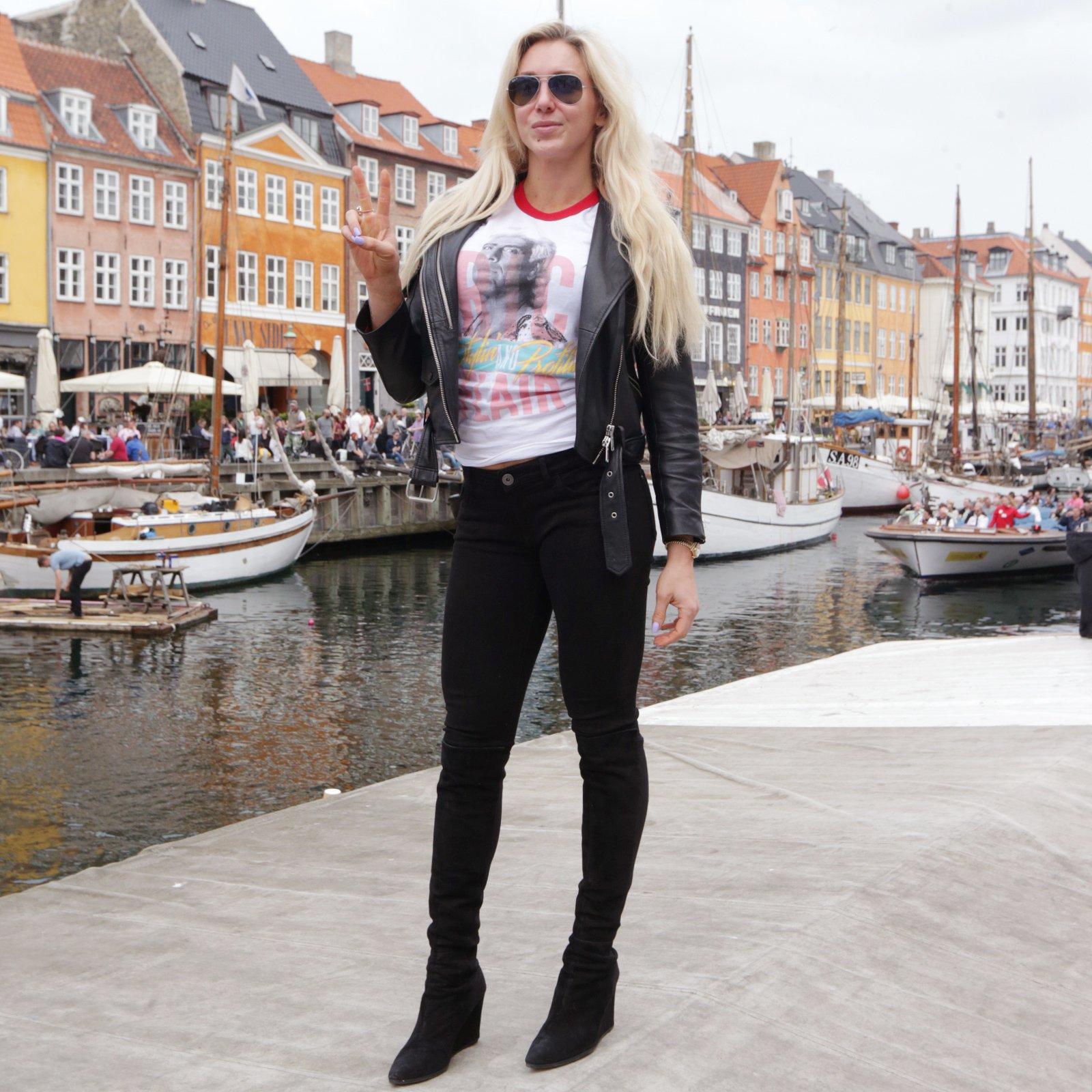 Charlotte Flair poses in front of the waterfront in Copenhagen, Denmark.