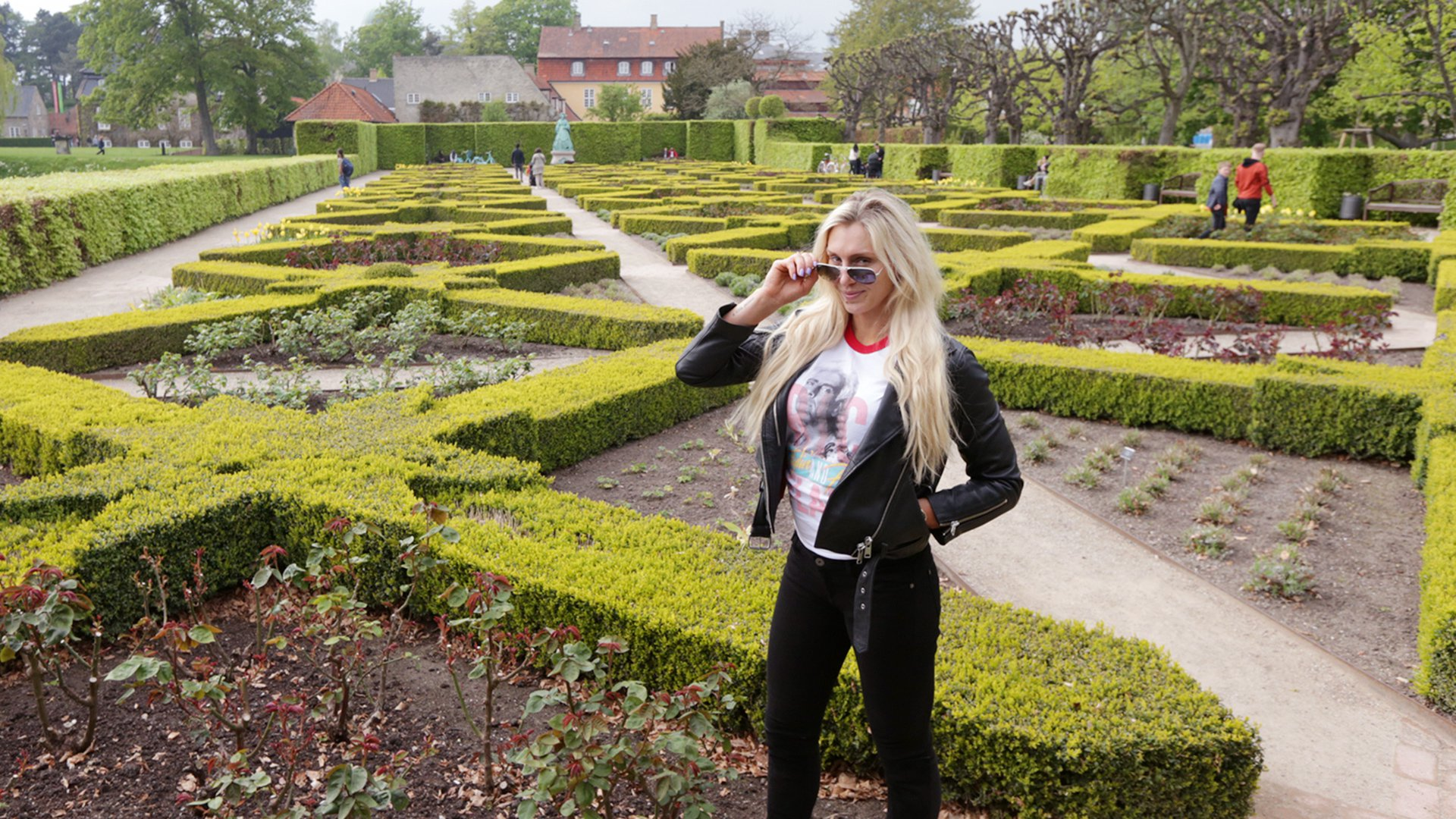 The Queen poses in front of The King's Garden.