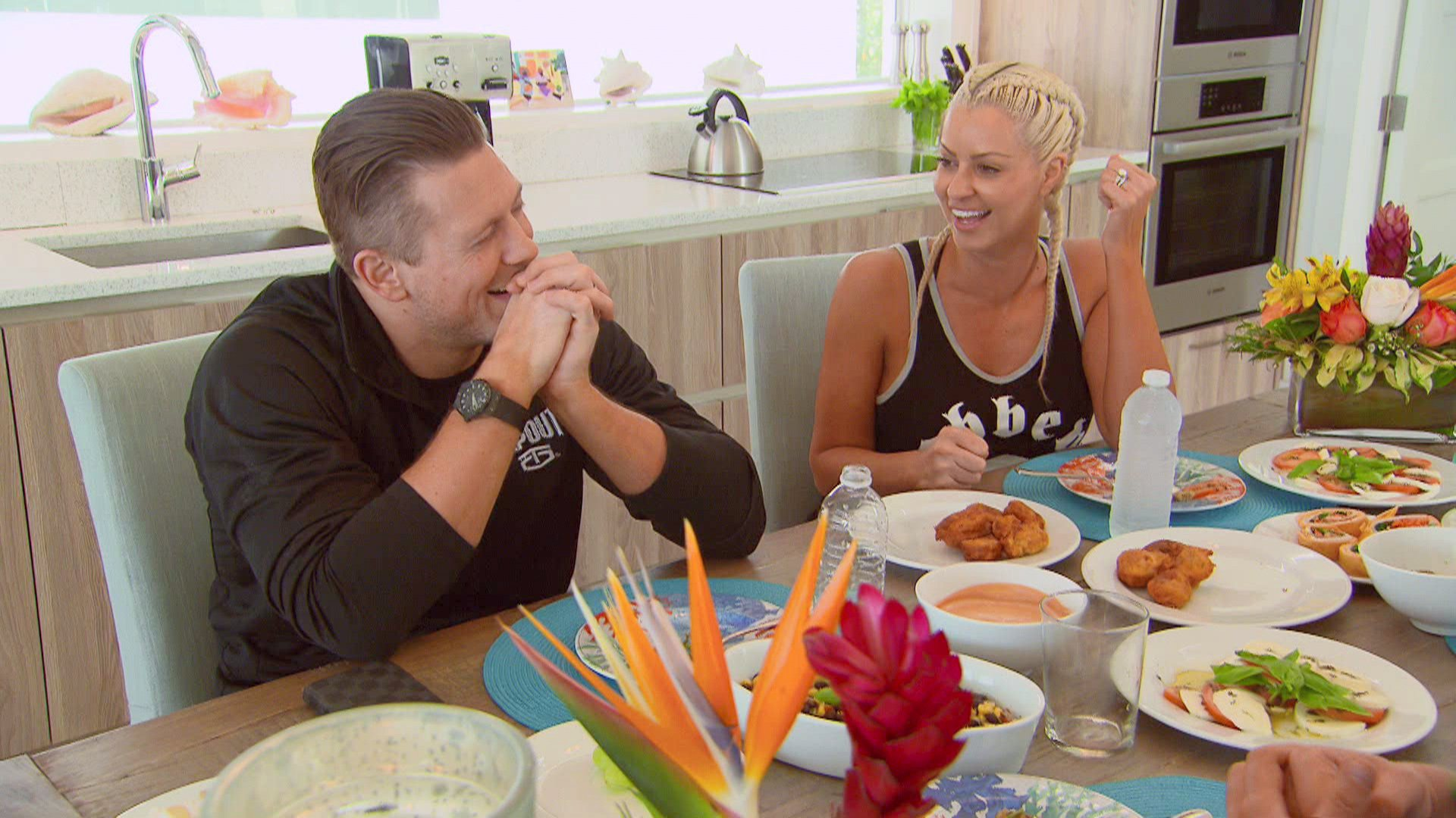 While Miz is preoccupied with spear-fishing, Maryse demands a romantic swim with the island's native pigs.