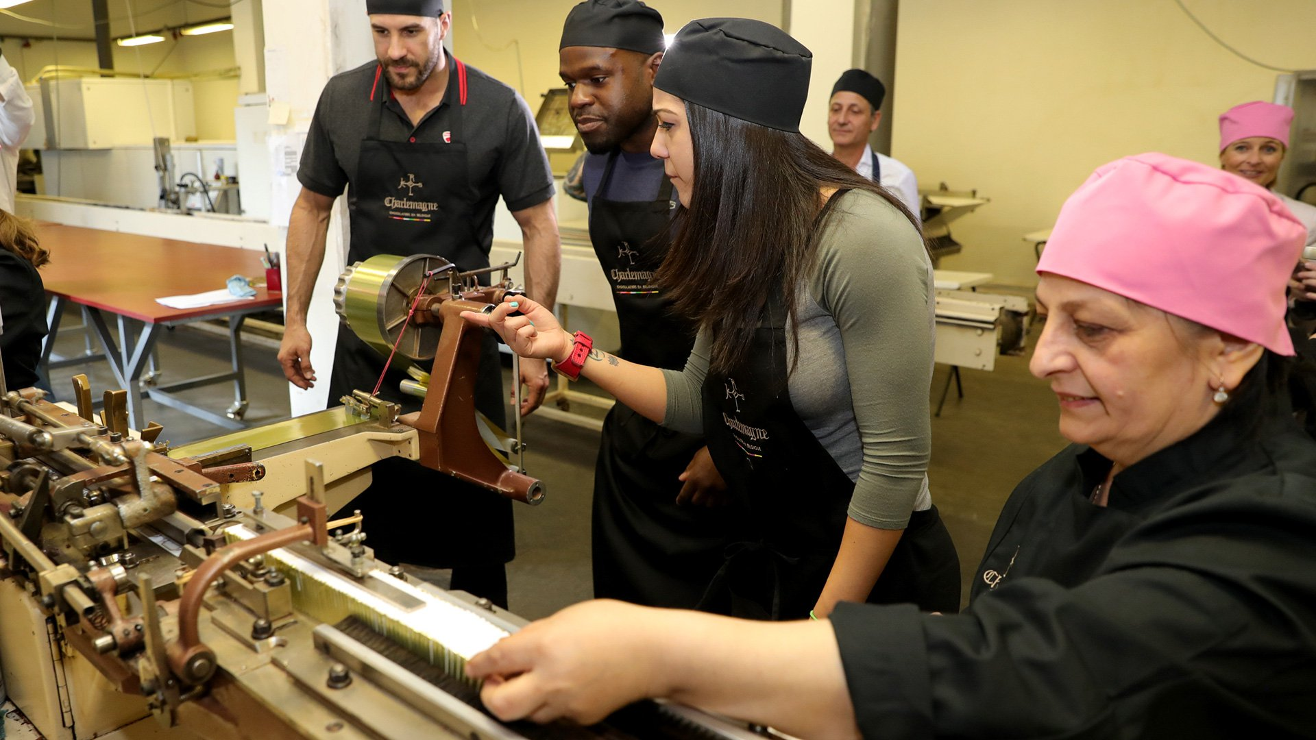 Cesaro, Apollo and Bayley get an up-close look at what goes into making that delicious Belgian chocolate.