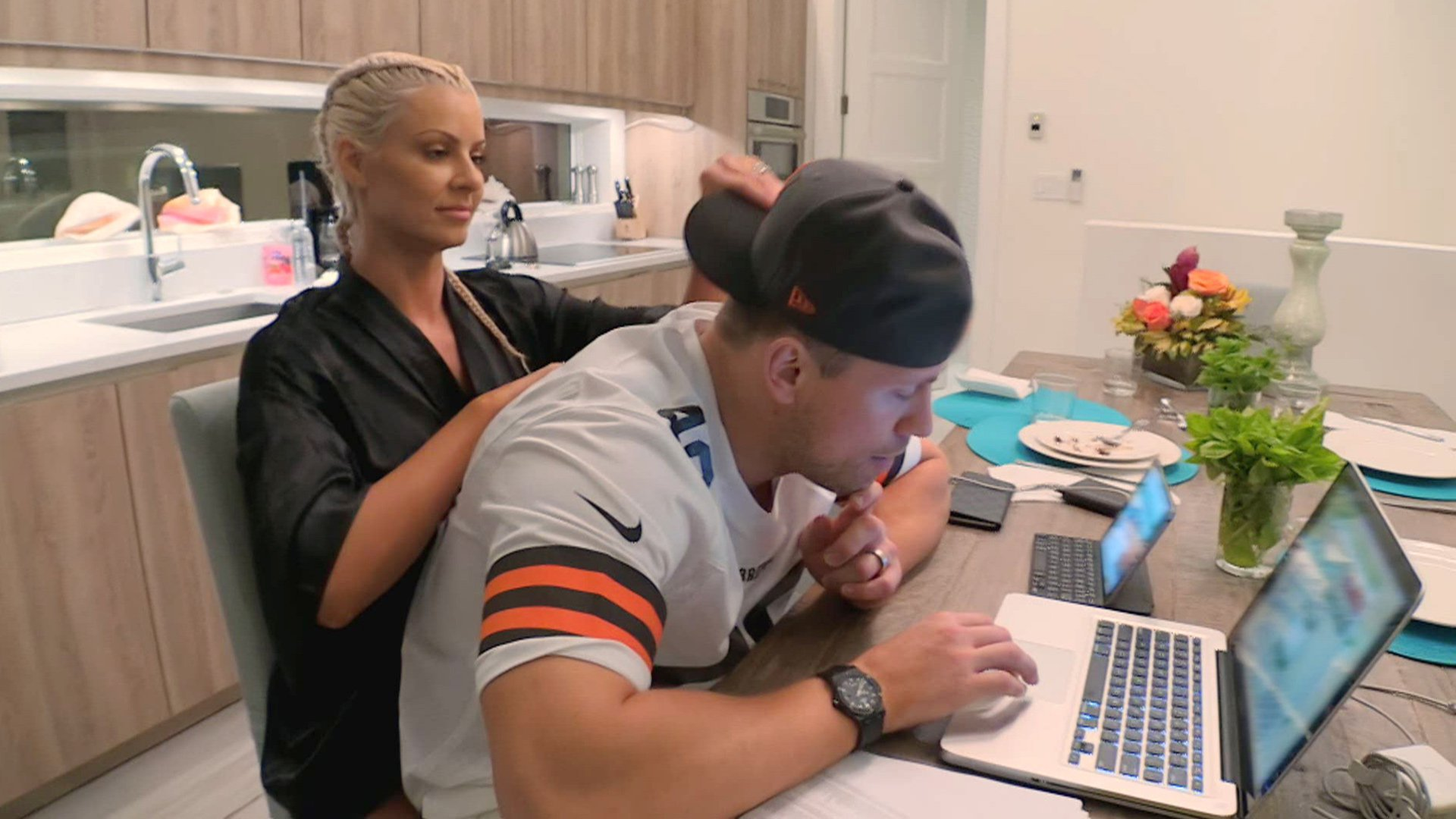 Maryse tries to distract The Miz from his fantasy draft. No dice.