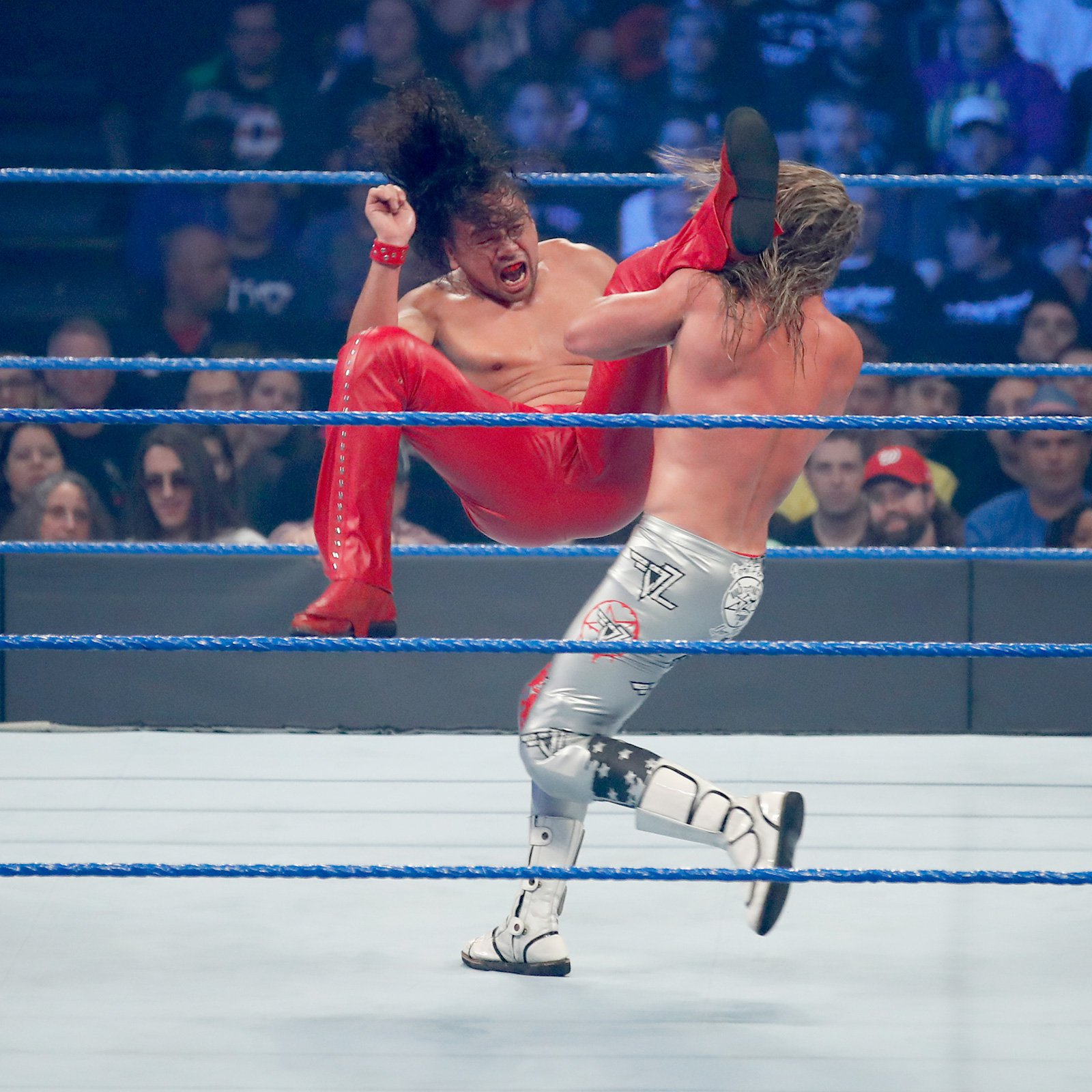 Nakamura levels his opponent with an impactful heel kick.