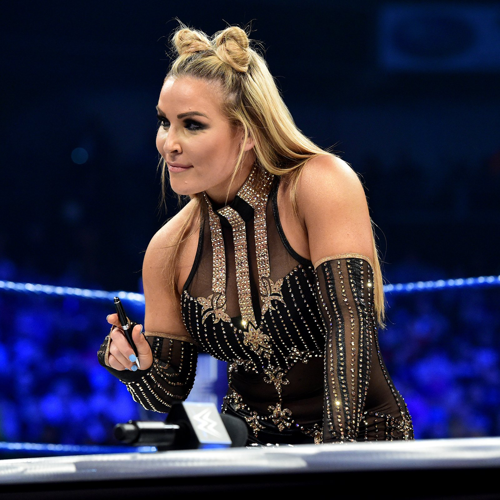 Natalya signs the dotted line...