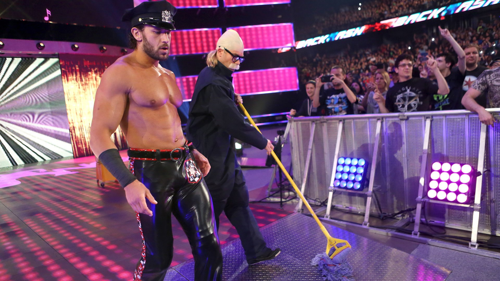 Fandango and an undercover Tyler Breeze make their way to the ring.