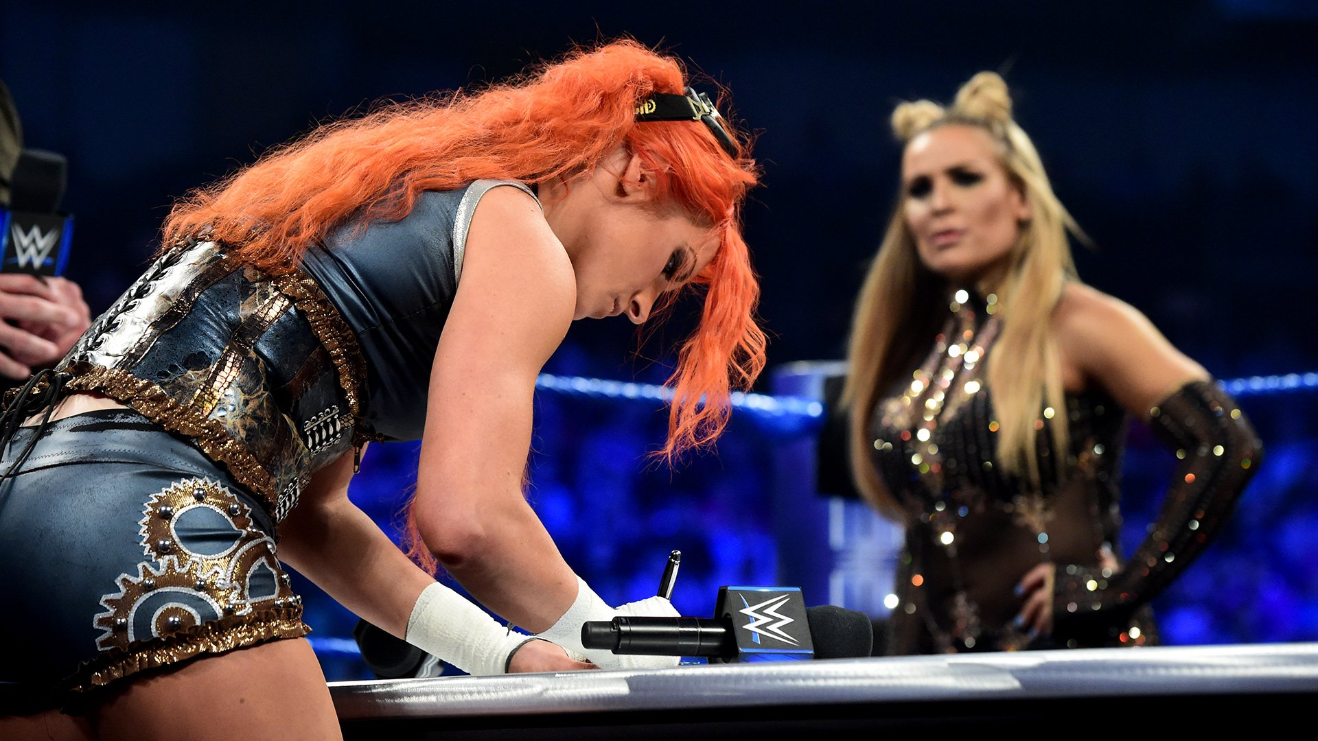 ... and she signs the contract for WWE Backlash this Sunday.