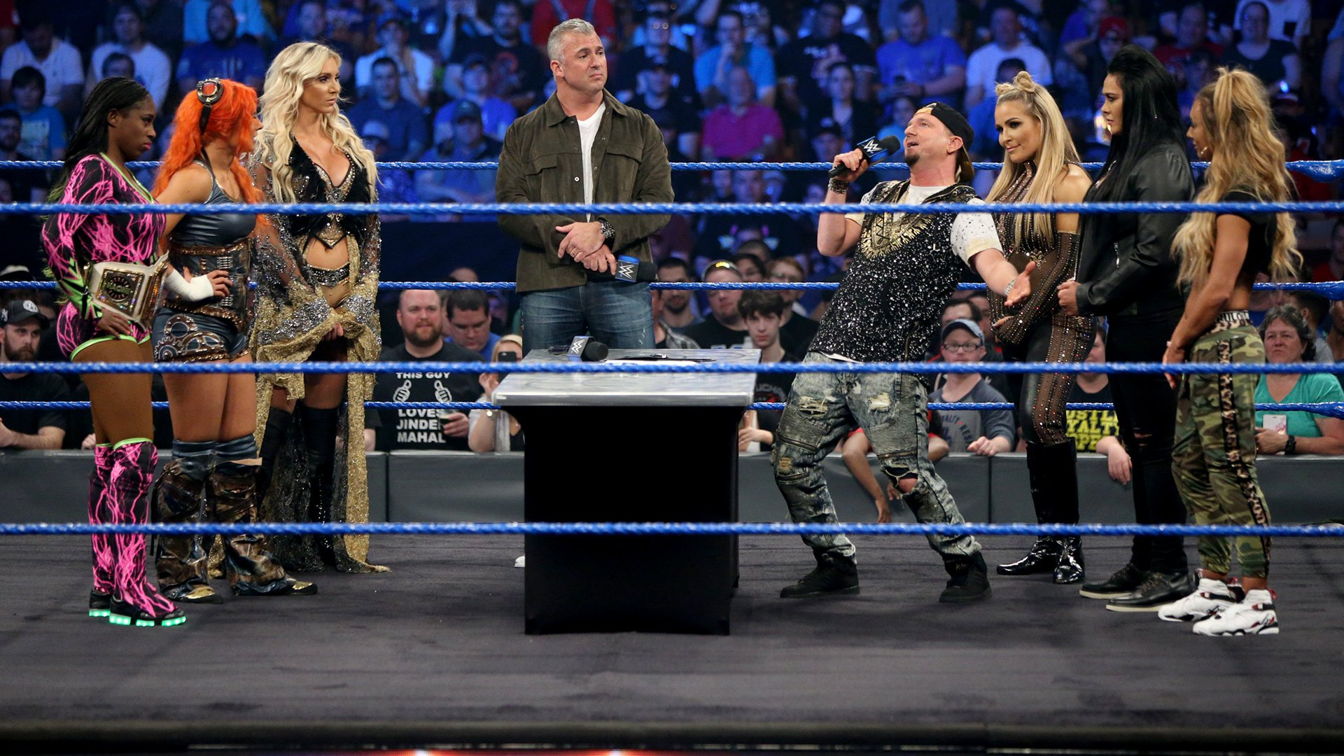 Ellsworth begins to insult Naomi, Charlotte and Becky...