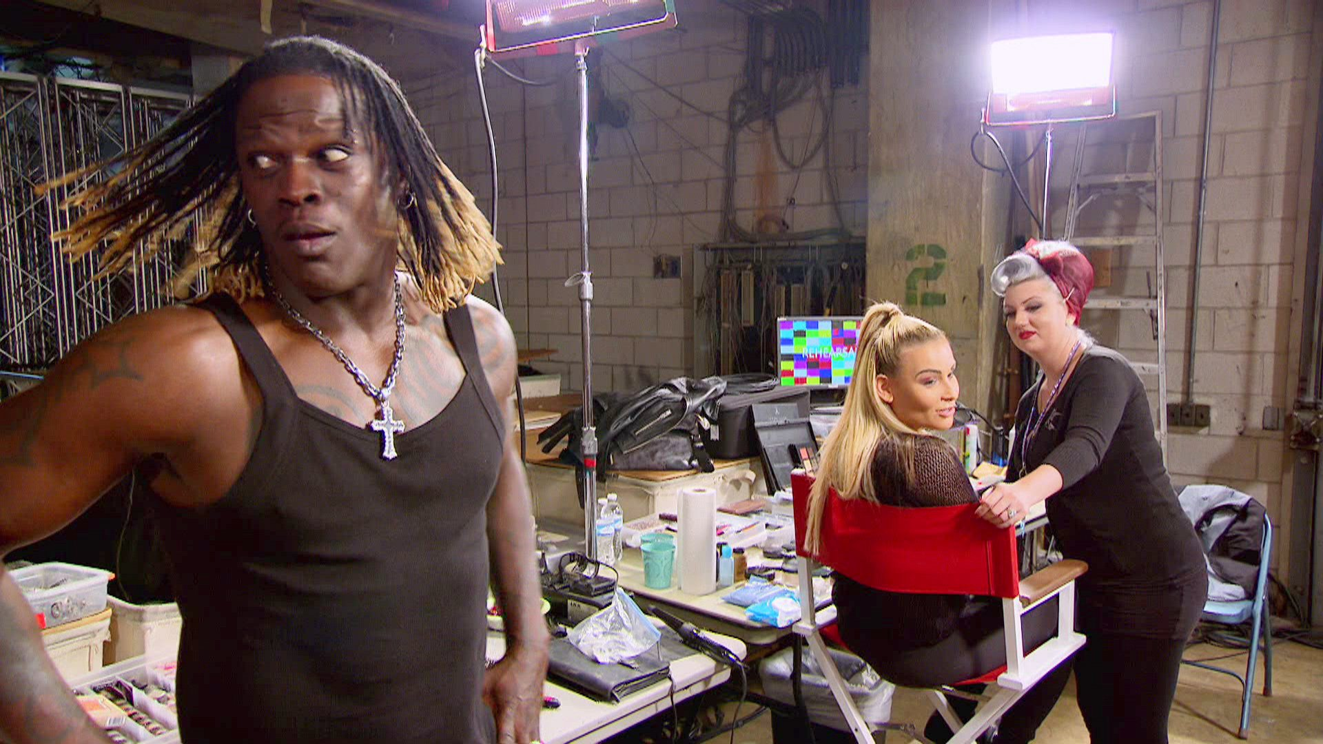 Natalya and Renee, having made up, cajole R-Truth into taking sides in the immortal cats vs. dogs argument.