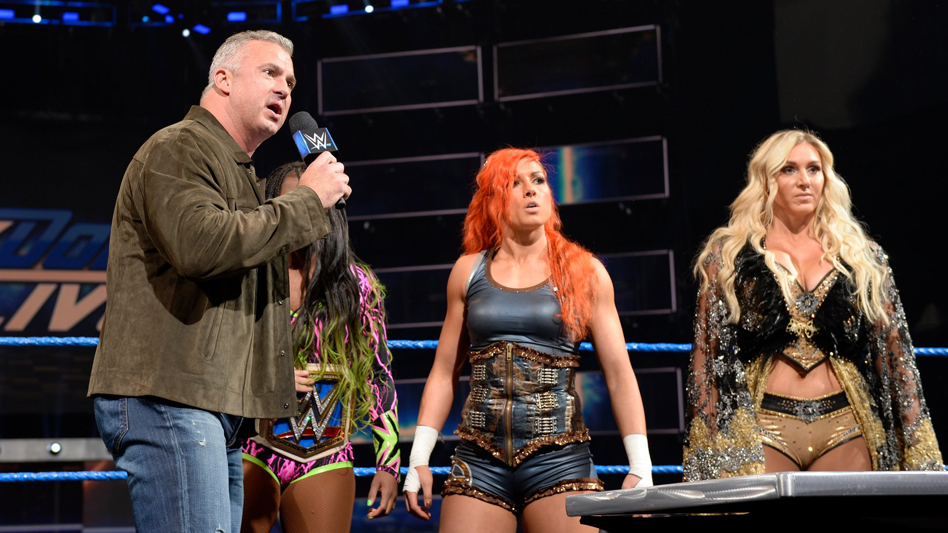 ... and puts Naomi in a match against Carmella for right now!