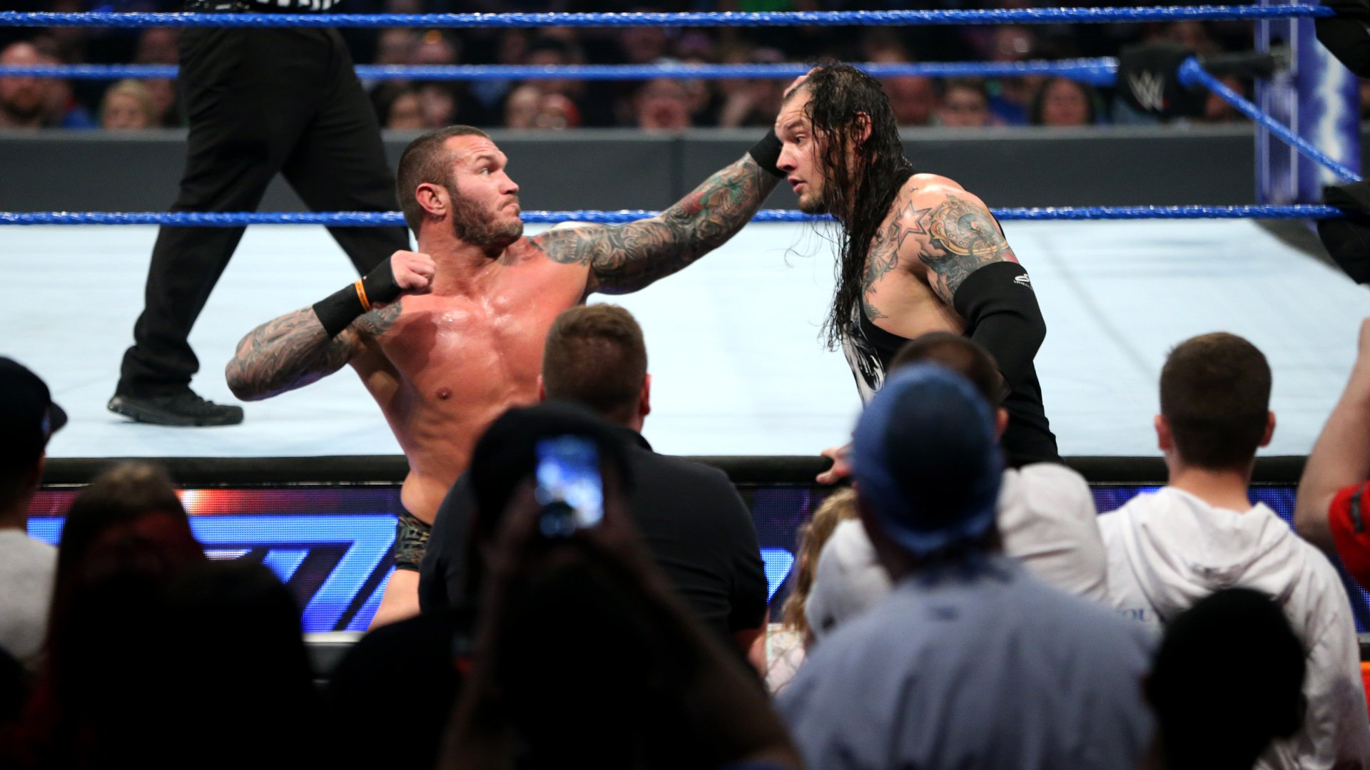 The Apex Predator brawls with Corbin on the outside.