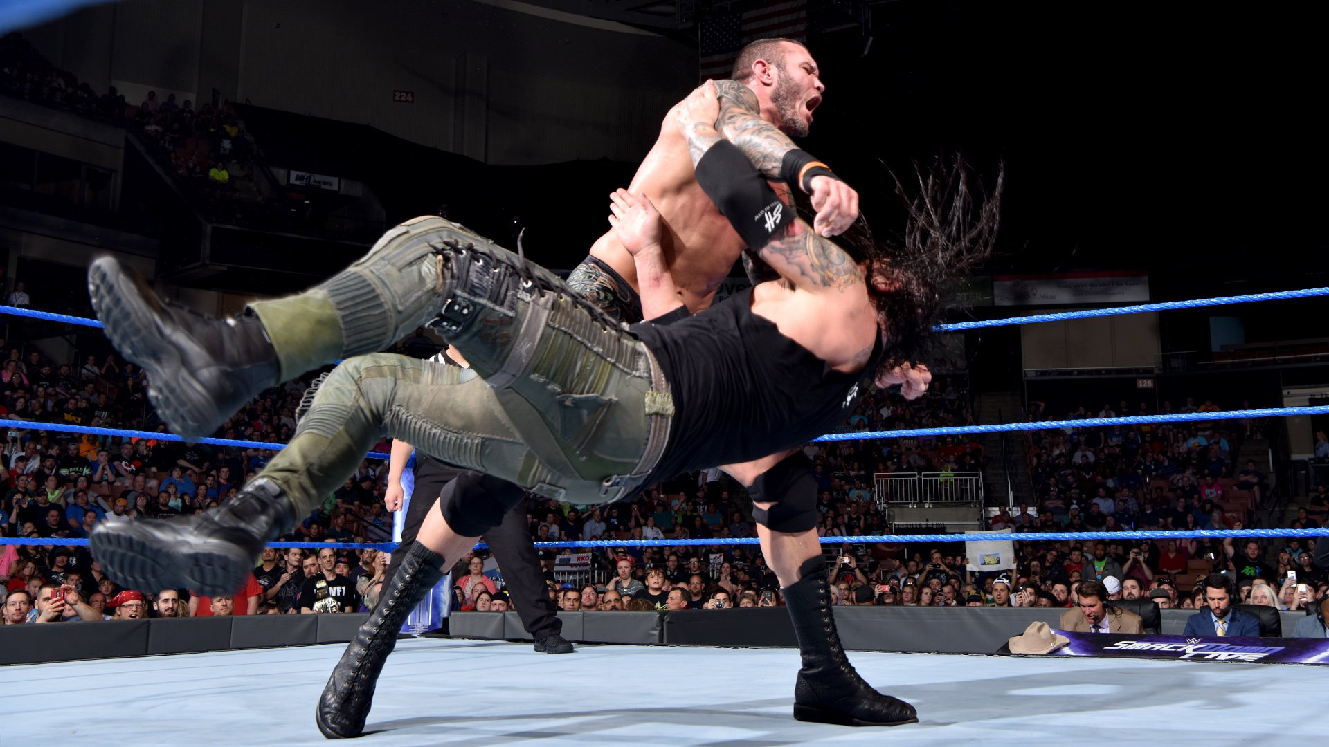 Orton sends Corbin to the mat with a clothesline...