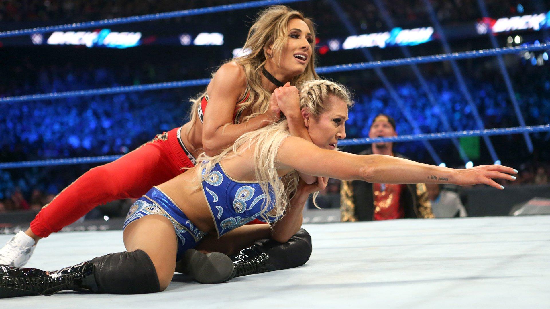 Carmella keeps Charlotte on the defensive.