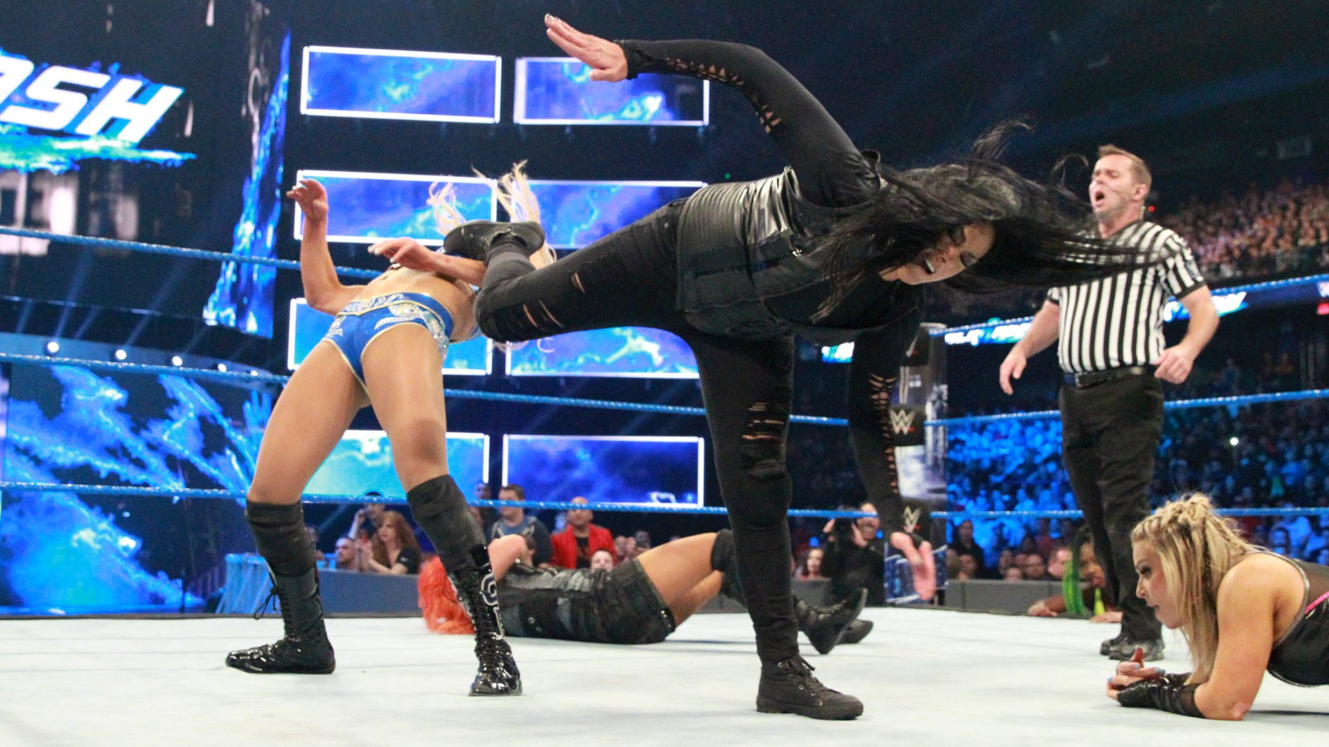 Tamina drops Charlotte with a perfectly executed superkick.