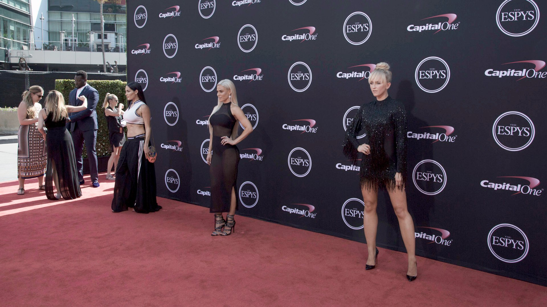 Maryse and Summer Rae pose on the red carpet.