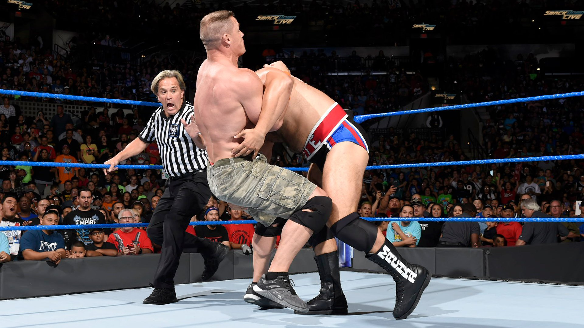 Suddenly, Rusev sneaks into the ring and attacks Cena!