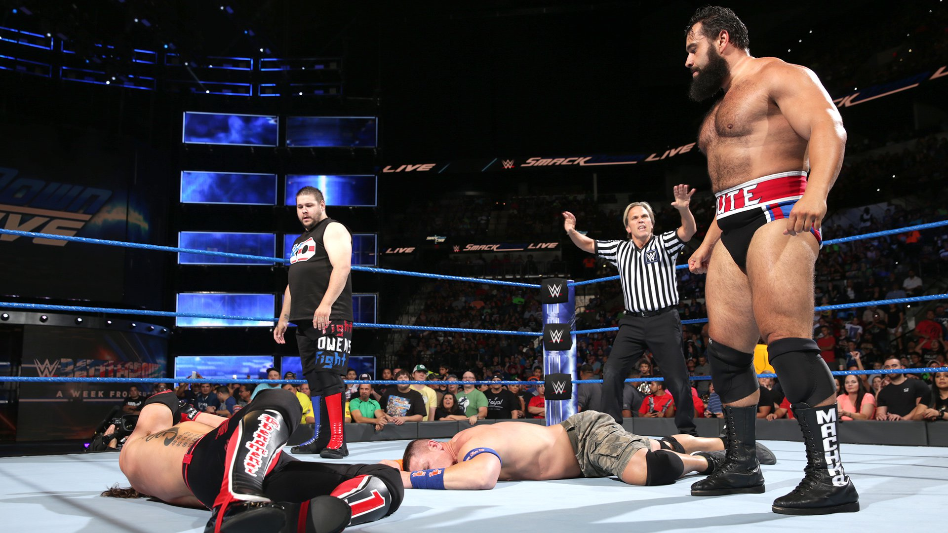 The Prizefighter and Rusev stand tall over their enemies.
