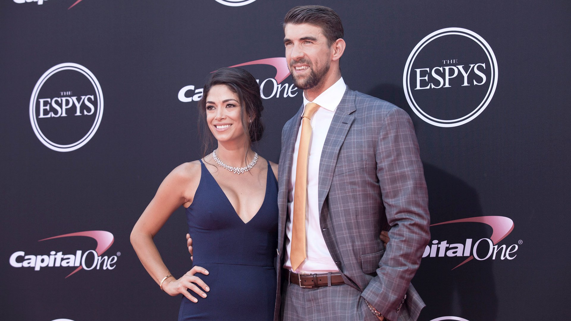 Olympic Gold Medal Swimmer Michael Phelps and his wife Nicole Johnson. Phelps won ESPYs for Record-Breaking Performance and Male U.S. Olympic Athlete.