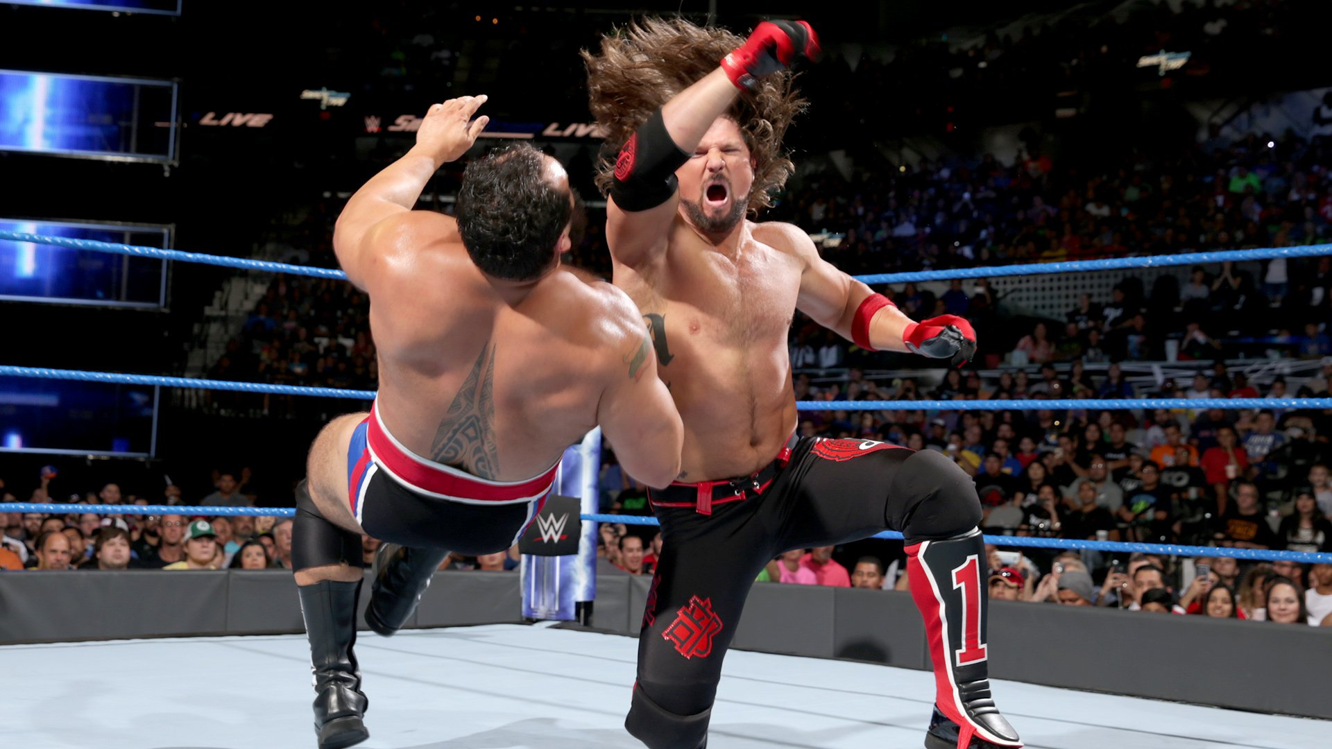AJ Styles gets the tag, drops Rusev to the canvas...
