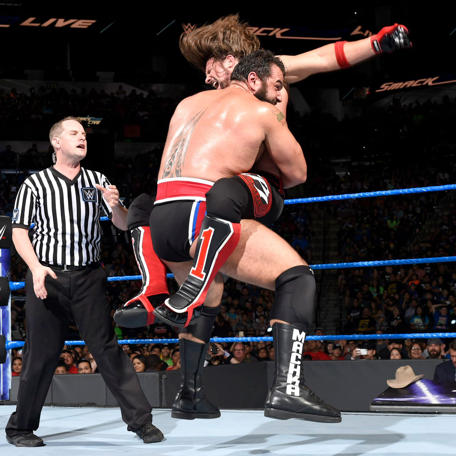 Rusev tries to slow the pace against The Phenomenal One...