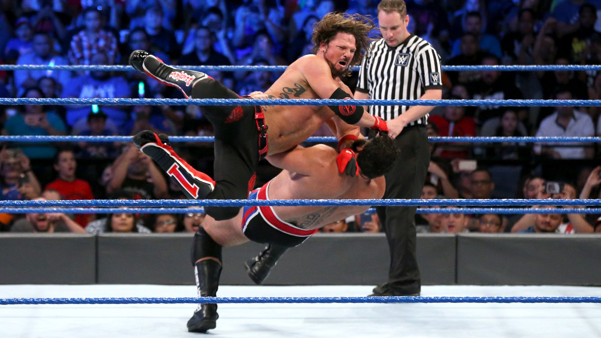 Styles tattoos Rusev with the Phenomenal Forearm...