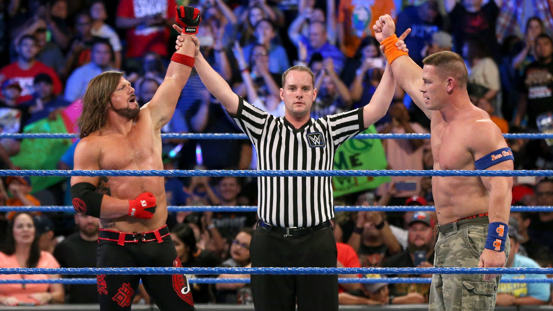 Styles and Cena stand victorious...