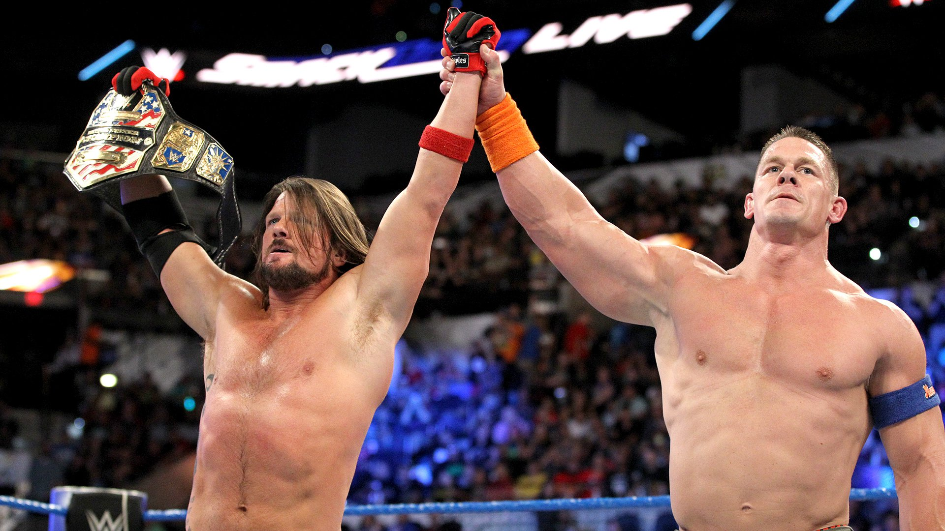 ... and Cena raises the arm of the United States Champion.