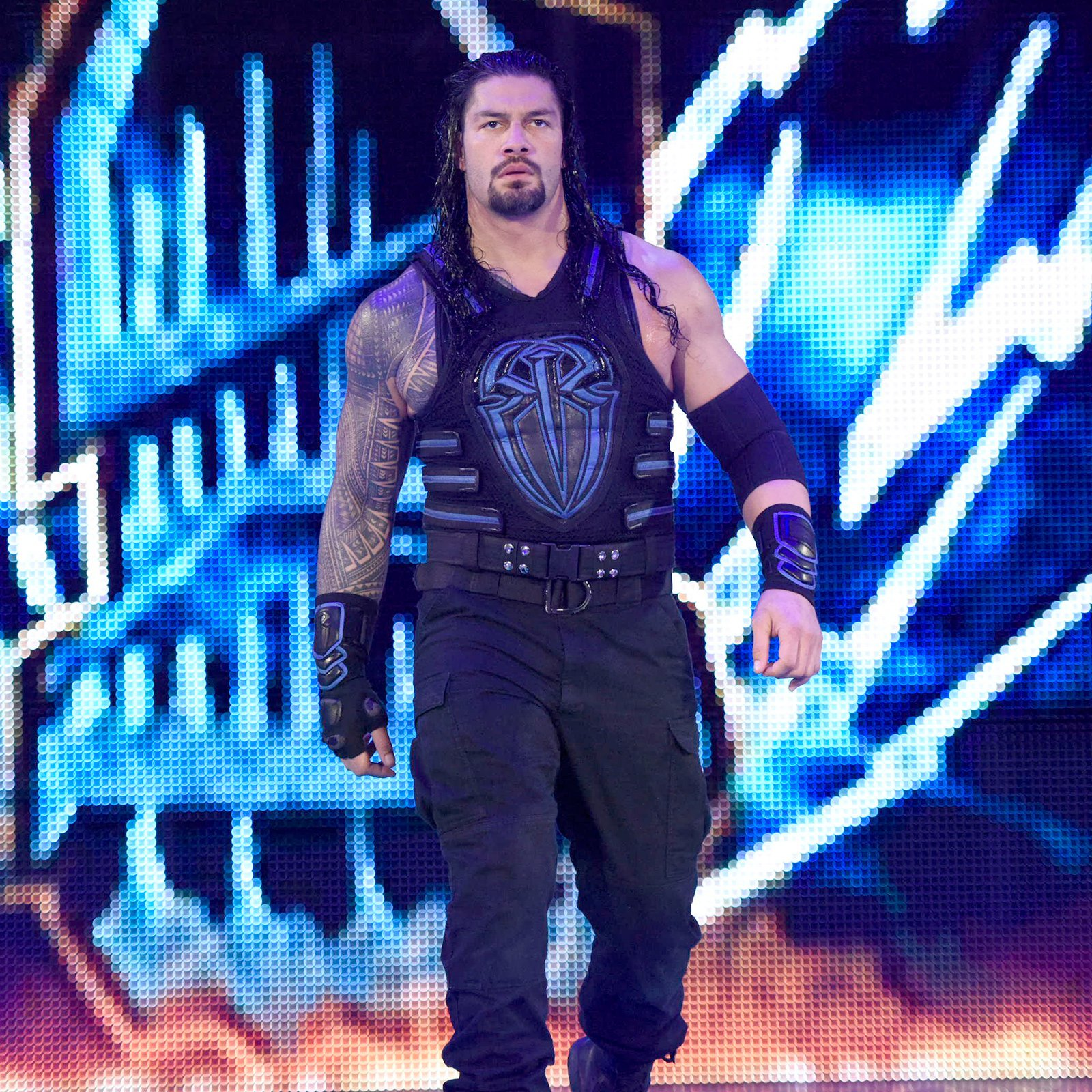 The Big Dog stares daggers through his nemesis on his way to the squared circle.