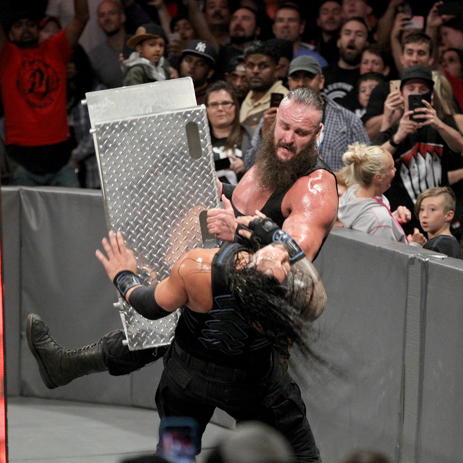 Strowman drives the steel steps right into The Big Dog's face!