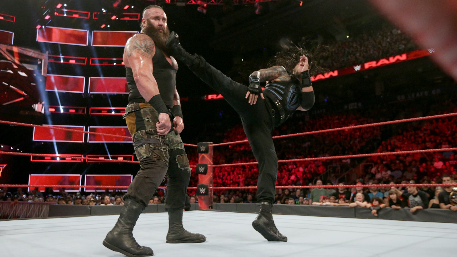 Reigns delivers a picture-perfect kick right into Strowman's jaw...