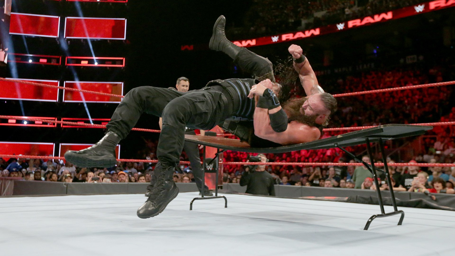 The Big Dog drops The Monster Among Men through a table with a Samoan Drop!