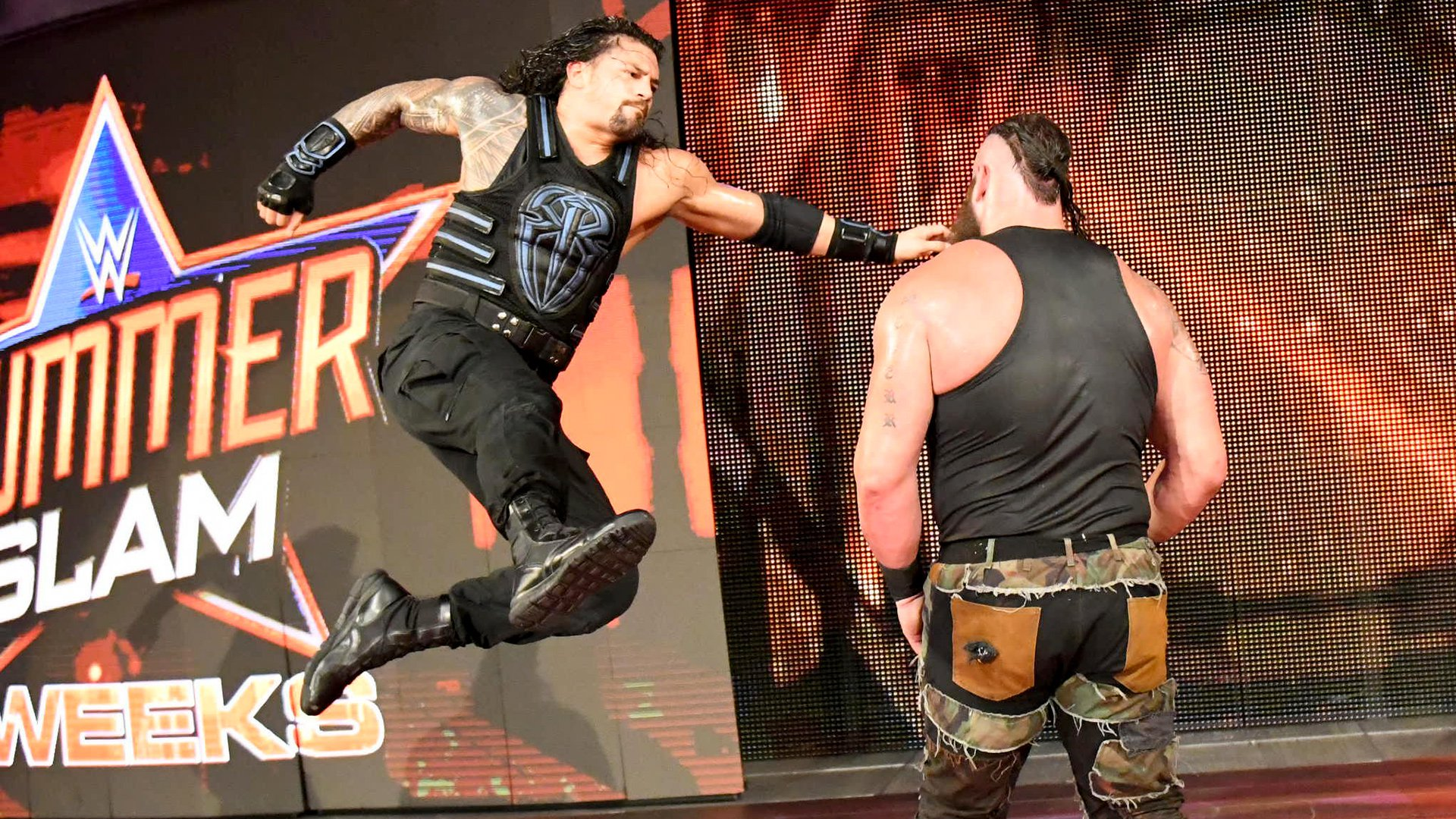 Reigns battles back with a Superman Punch...