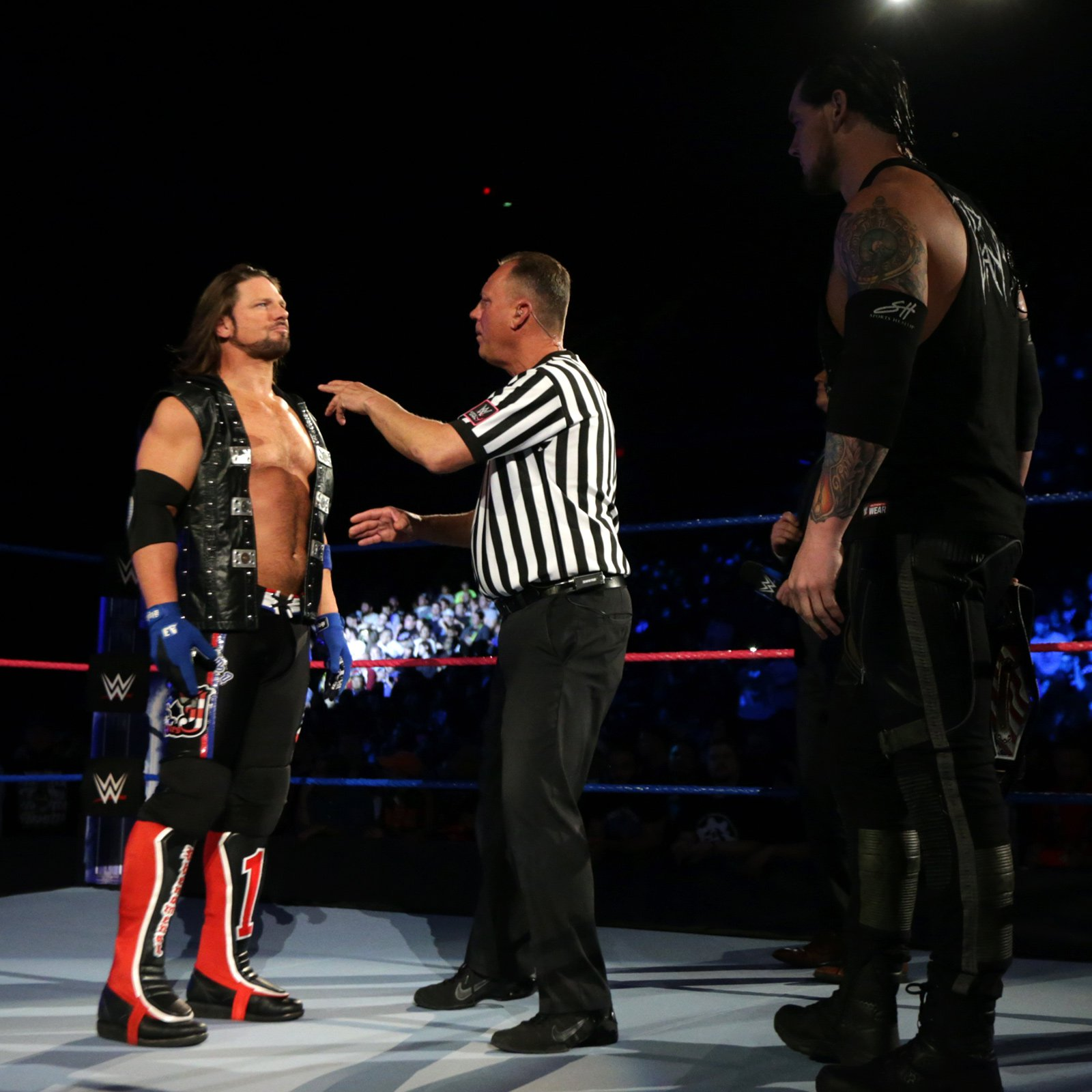 United States Champion Baron Corbin and AJ Styles prepare to battle for the star-spangled title.