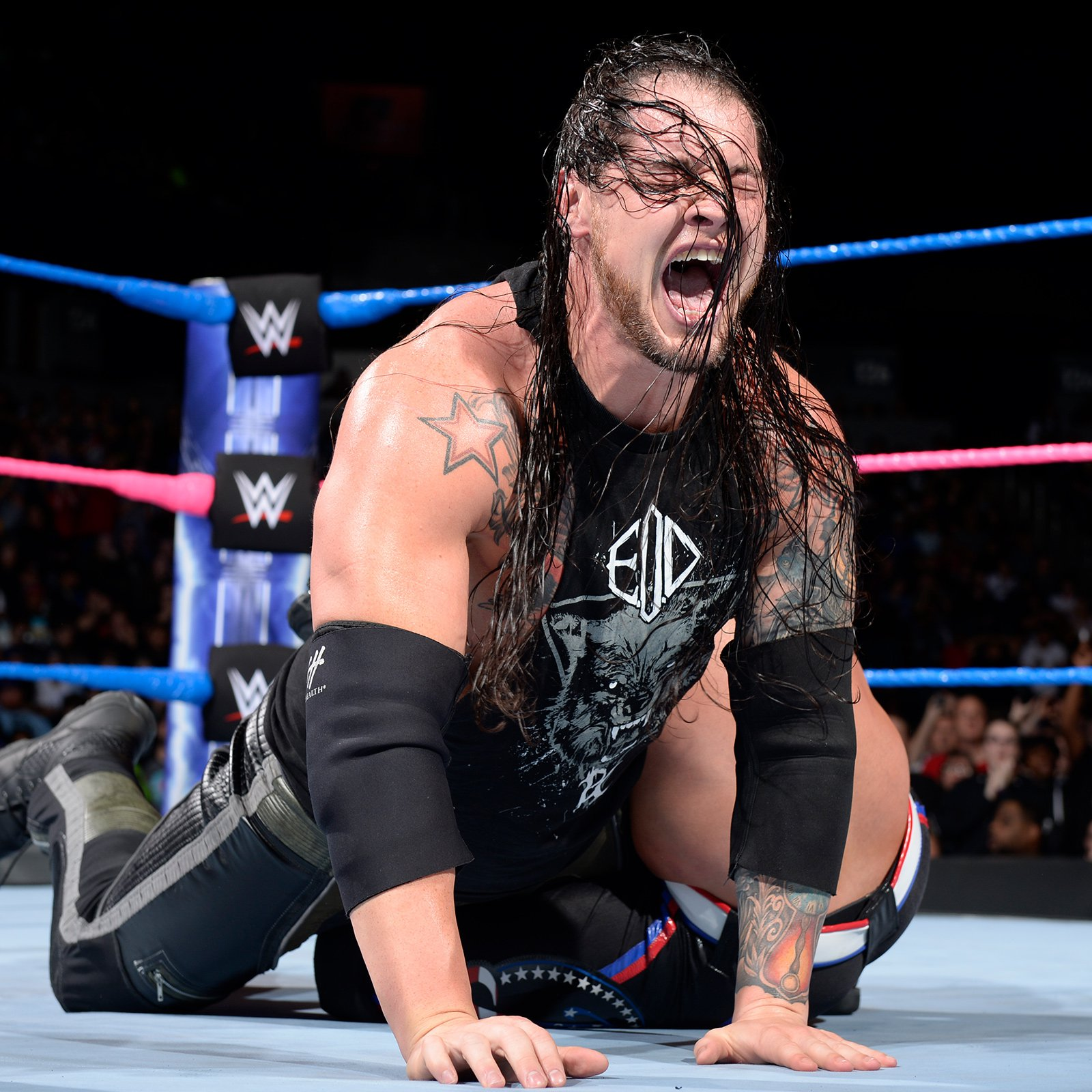 Styles locks Corbin in the Calf Crusher, but The Lone Wolf escapes by slamming AJ's head off the canvas.